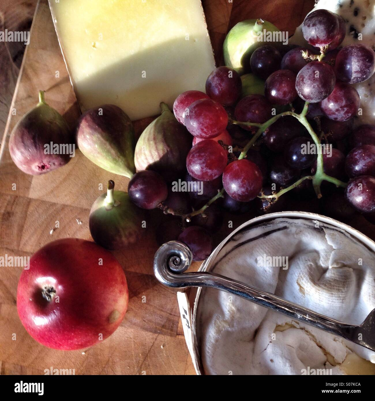Cheese board with fruit, after dinner Stock Photo