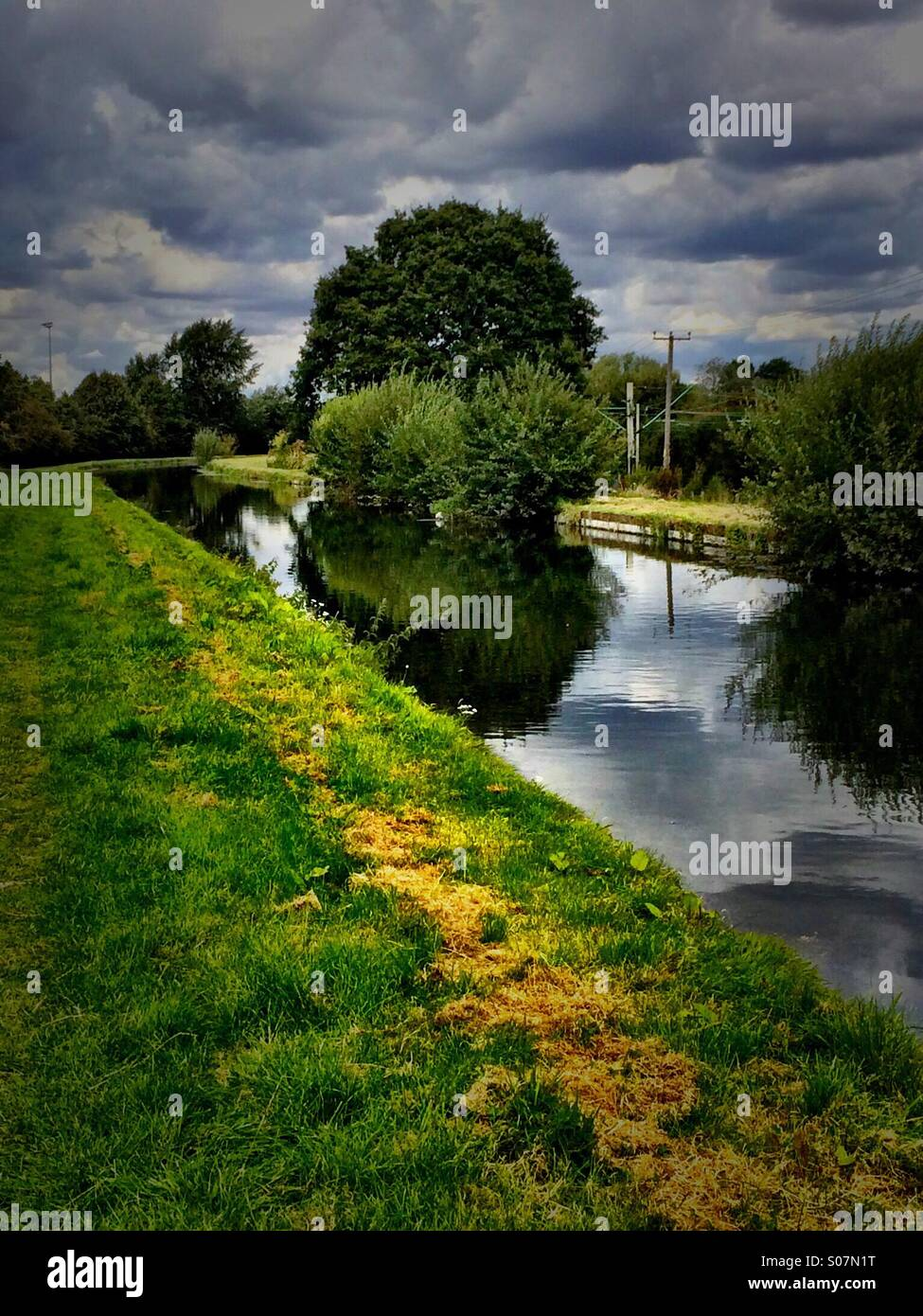 Walking on the towpath by the river - Stock Image
