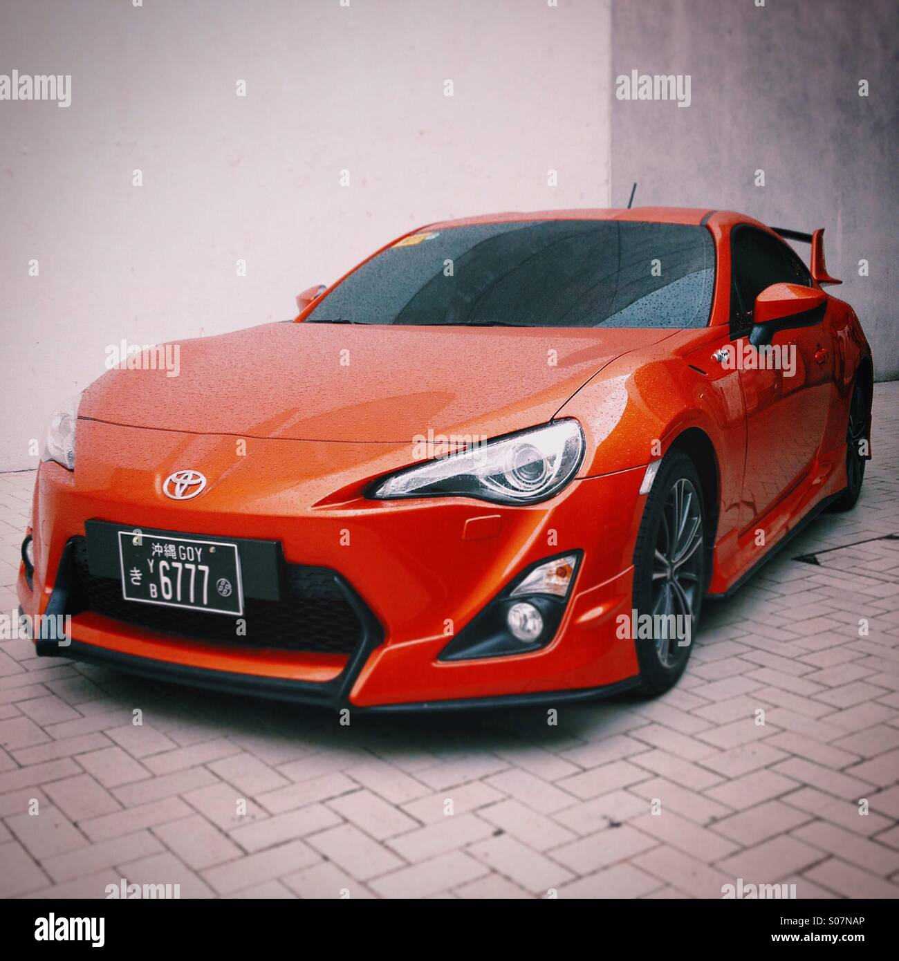 Bright Red Toyota Sports Car Parked On A Sidewalk In Central Manila,  Philippines