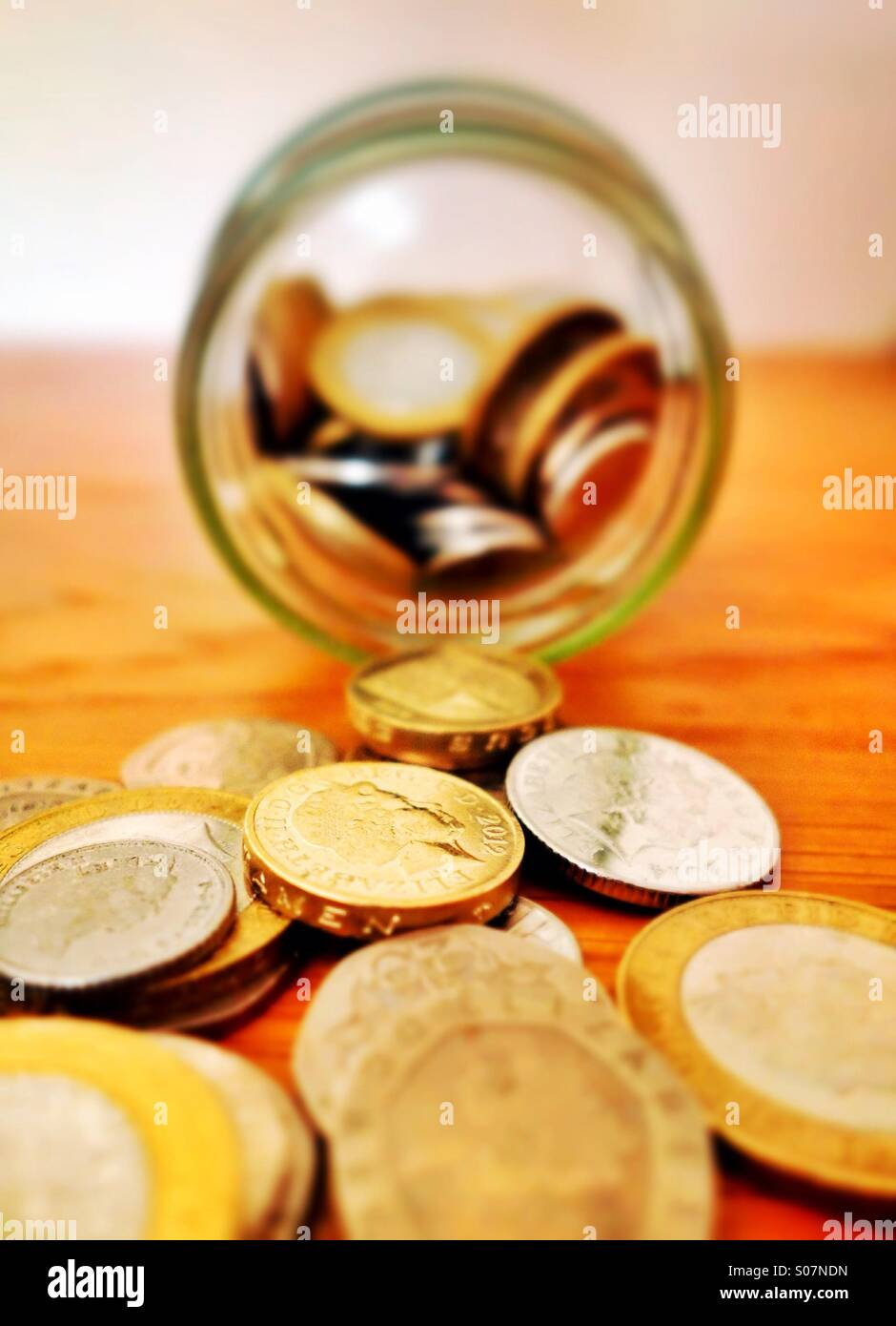 An emptied savings jar - Stock Image