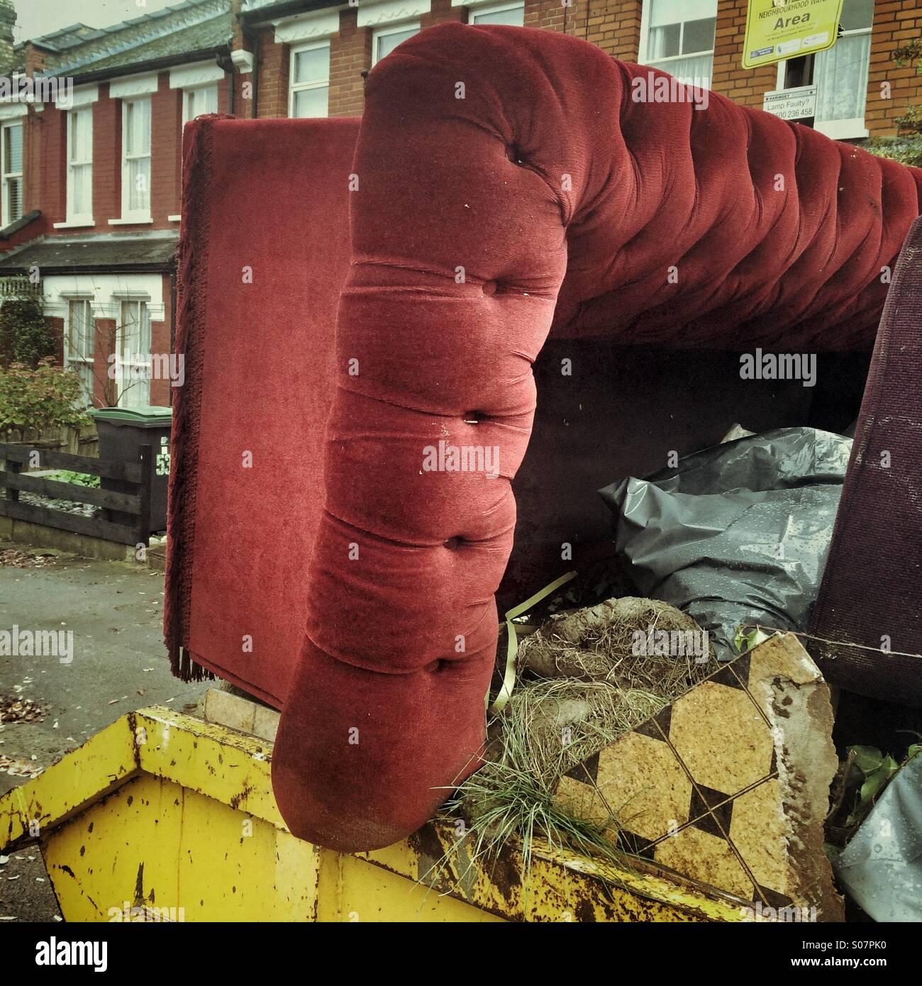A sofa in a skip - Stock Image
