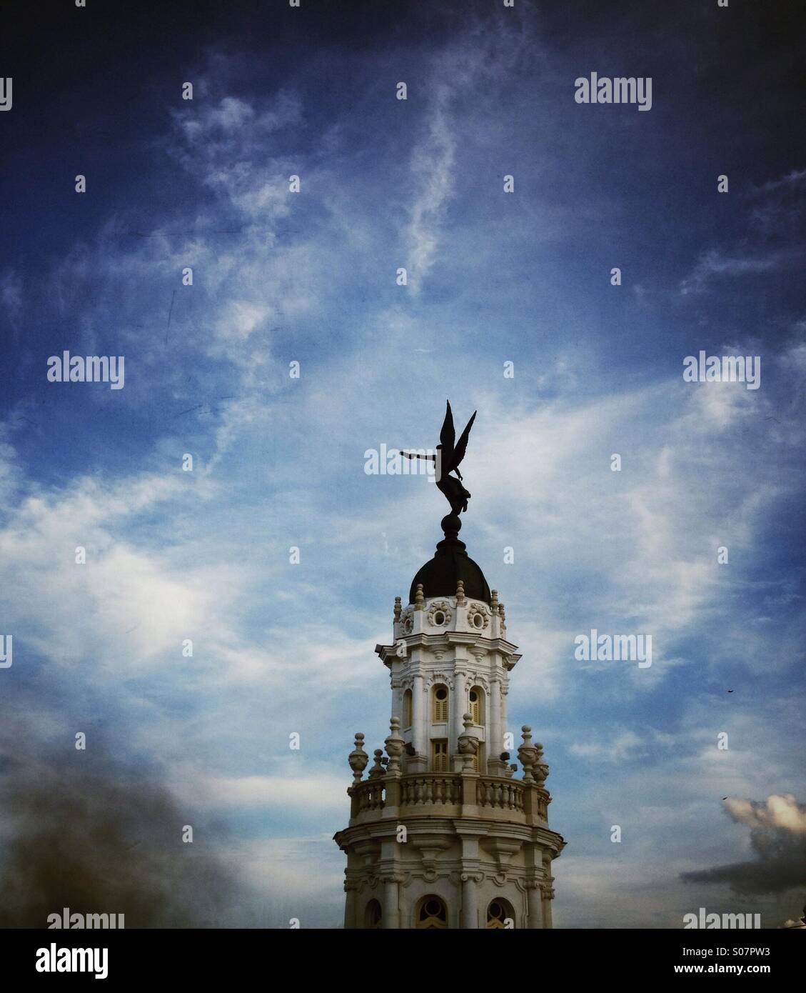 Winged angel statue adorning an ornate tower of The Grand Theatre Havana Cuba - Stock Image