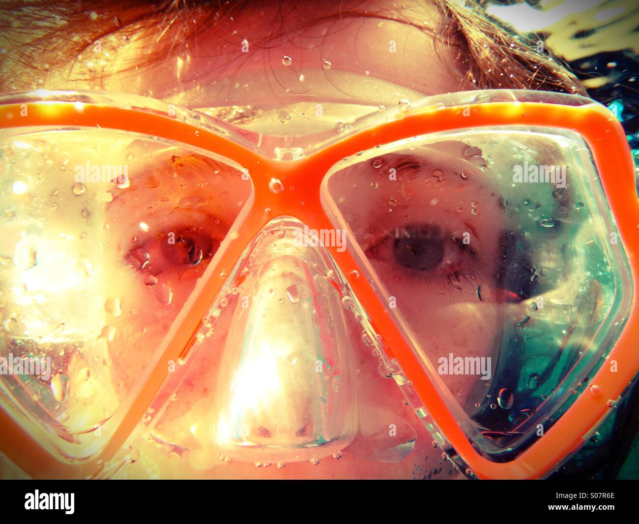 Underwater eyes - girl diver wearing goggles - Stock Image