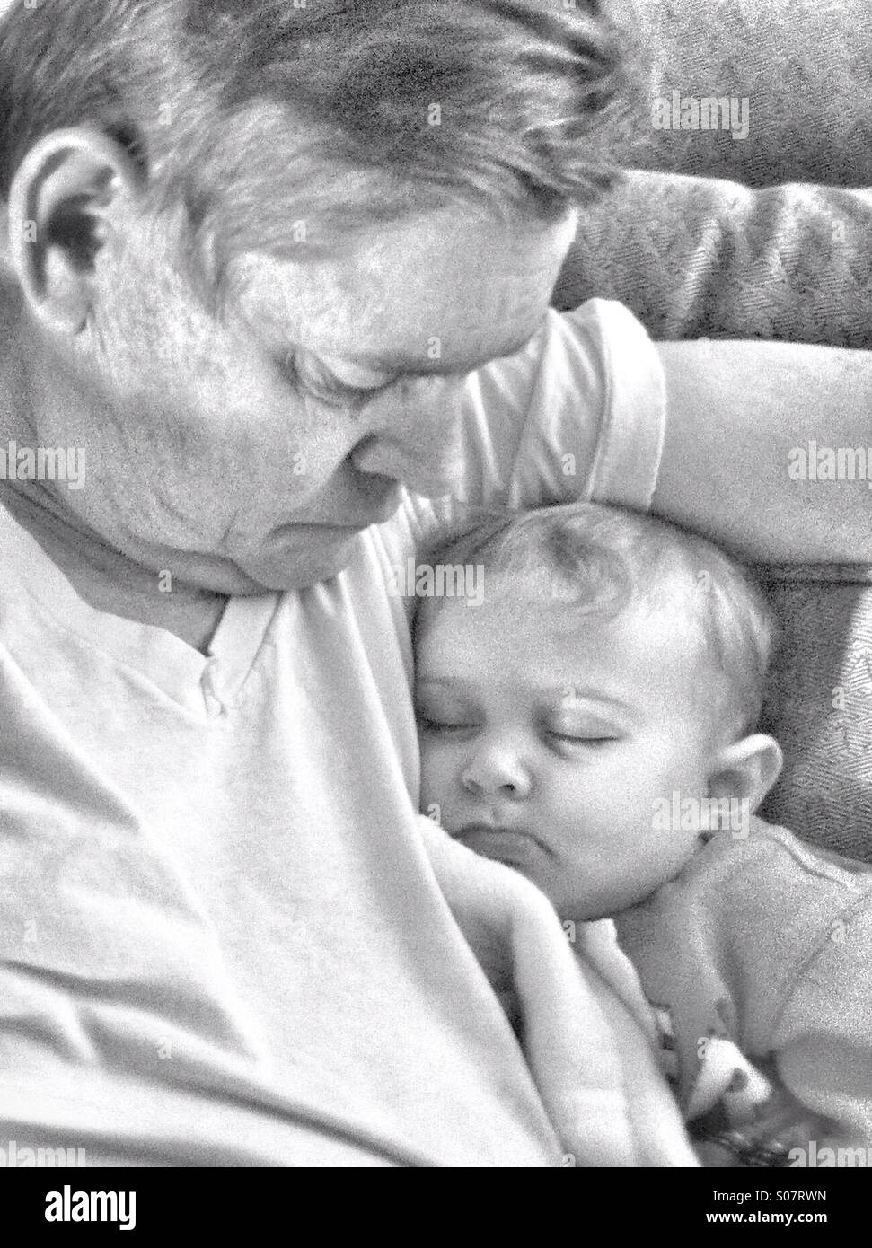 Soft sweet image of Granddad & Baby Boy Black and white - Stock Image