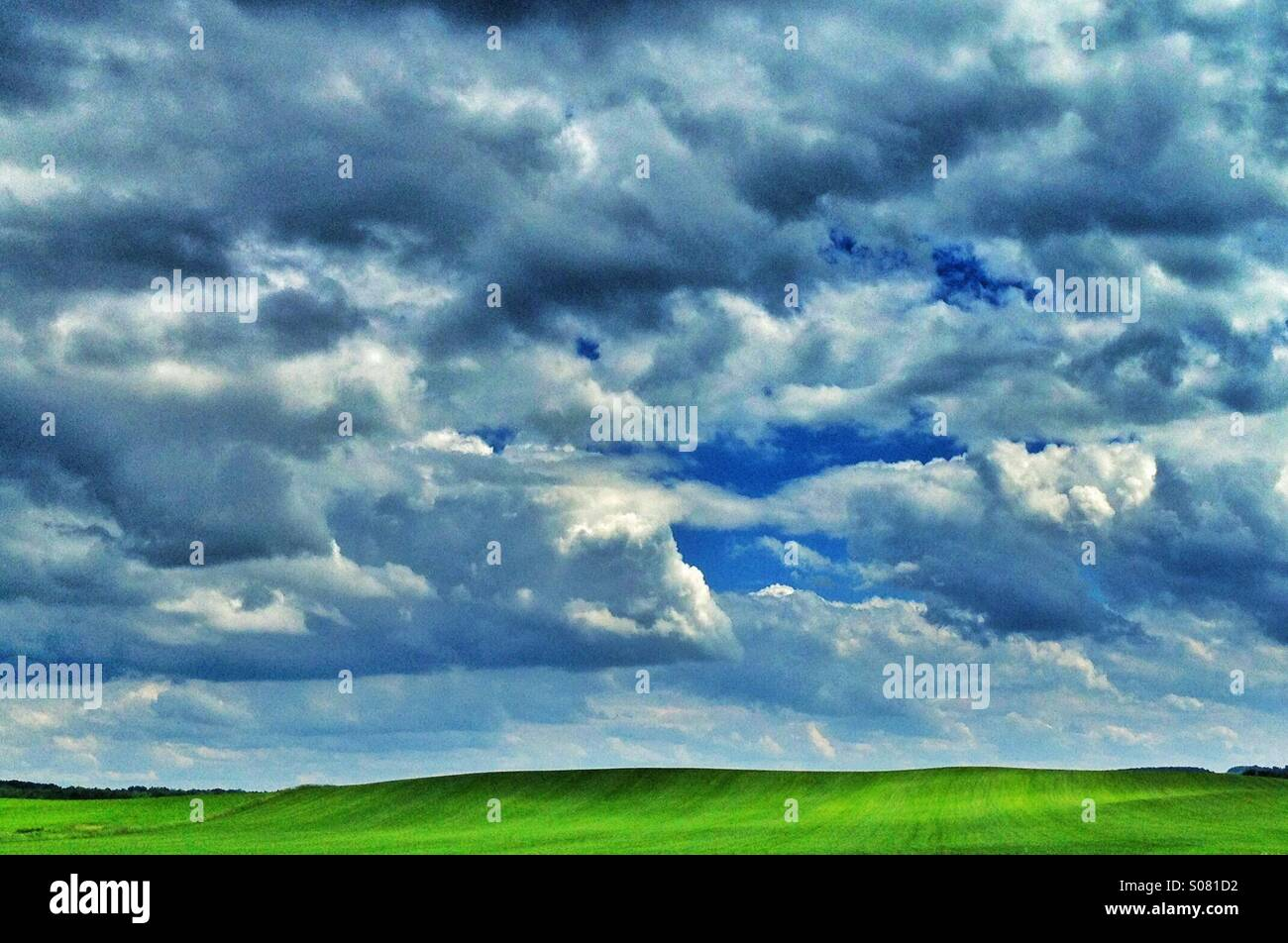 Rolling hills with clouds - Stock Image