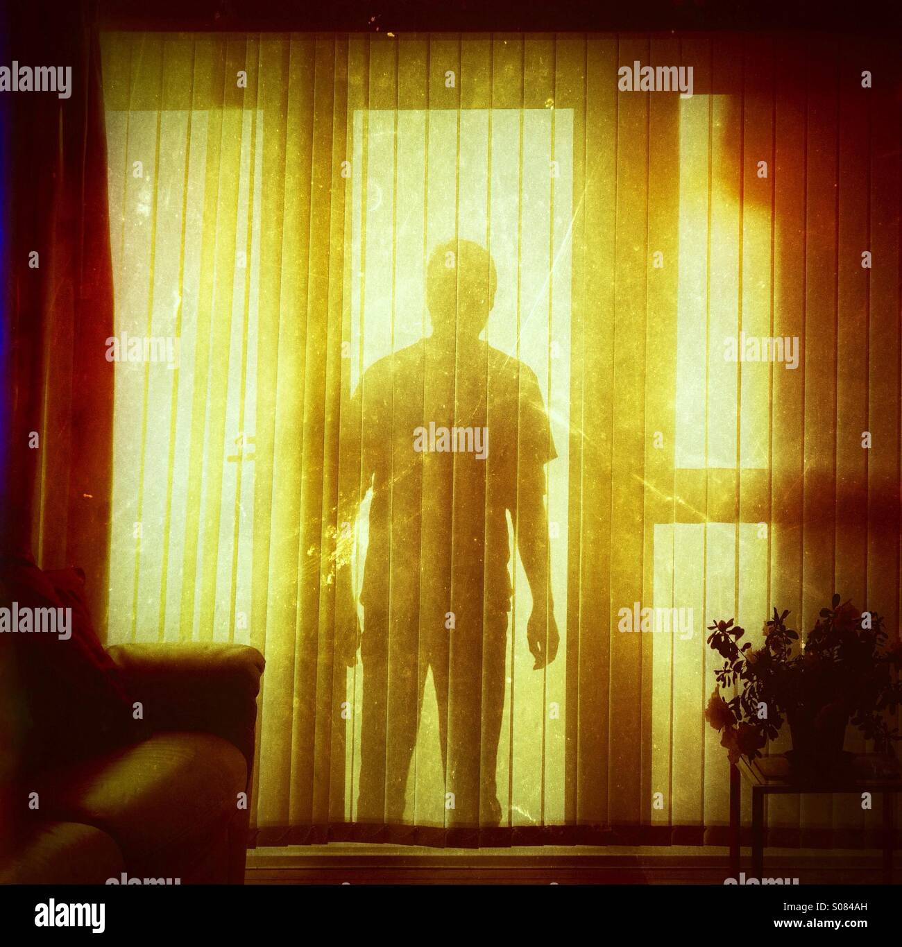 Shadowy figure at the window - Stock Image