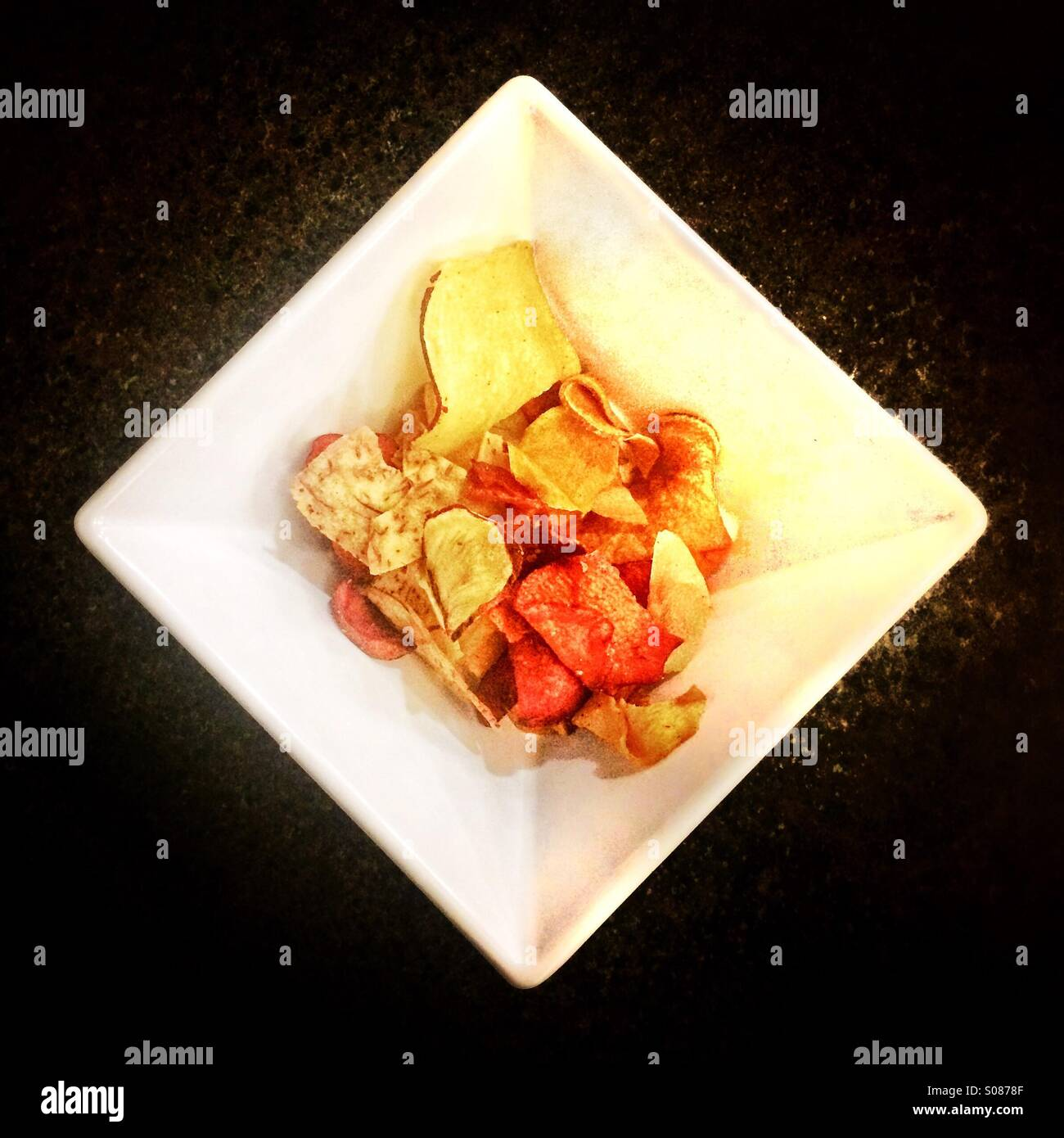 Potato chips in a bowl - Stock Image