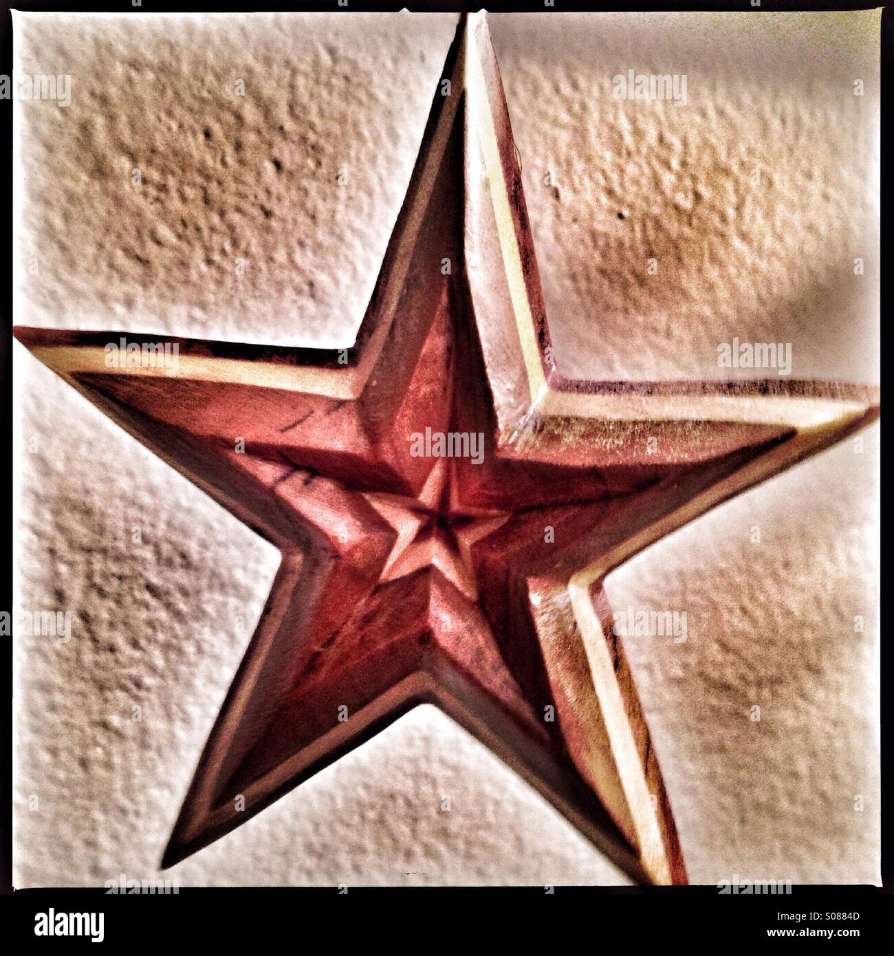 A wooden star. - Stock Image