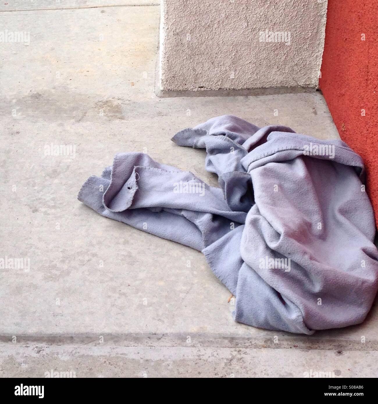 Homelessness, abandoned shirt - Stock Image