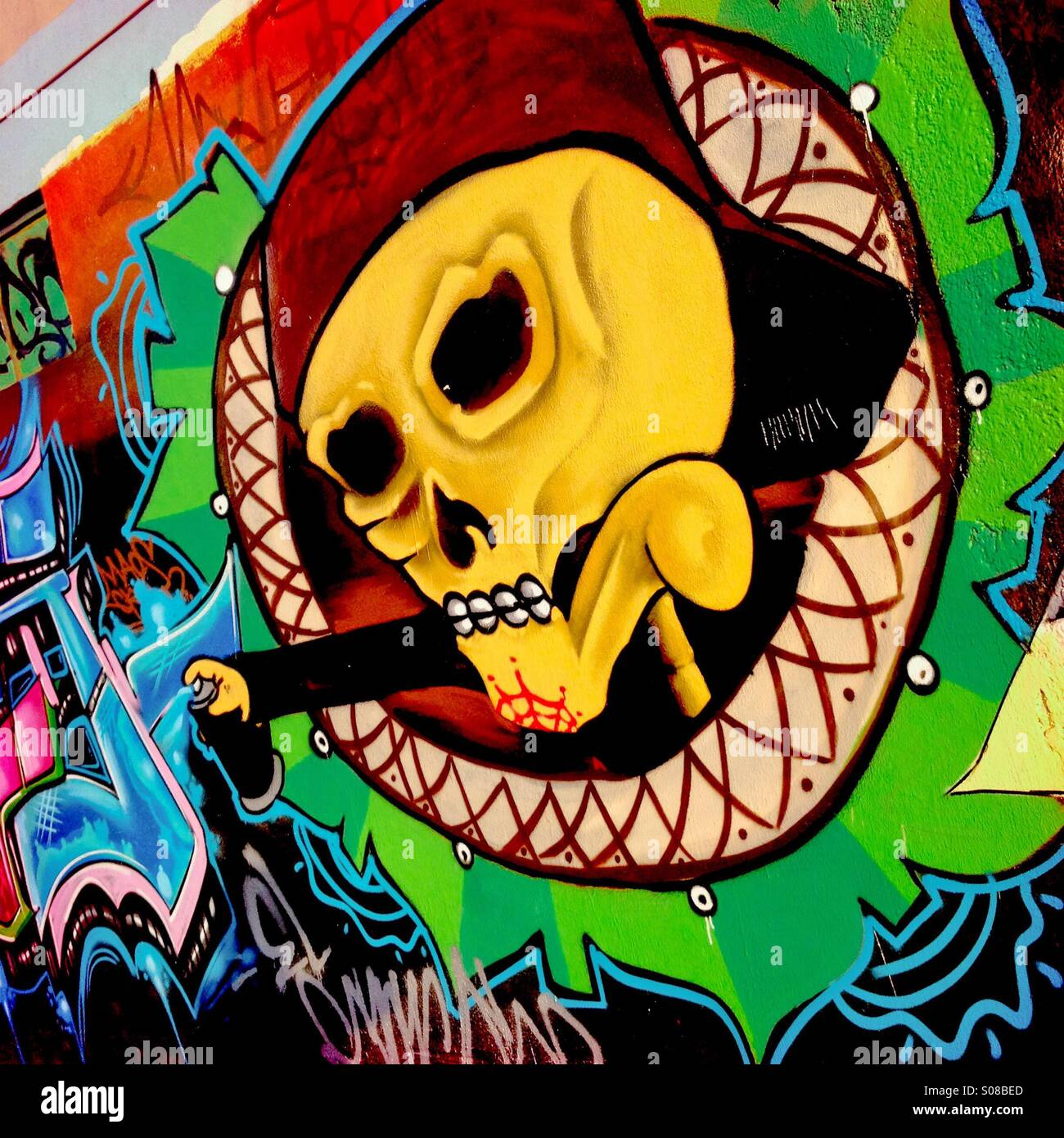 A skull graffiti artwork, illustrating the extensive Death worship culture in Mexico, appears on the wall in Morelia, - Stock Image