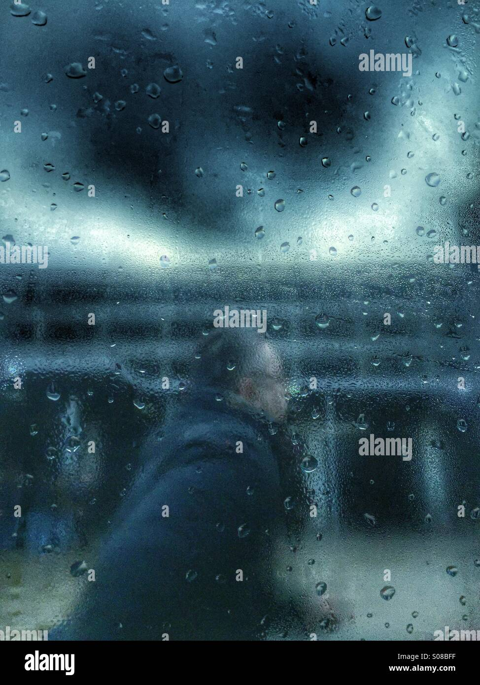 Man running in the rain Stock Photo