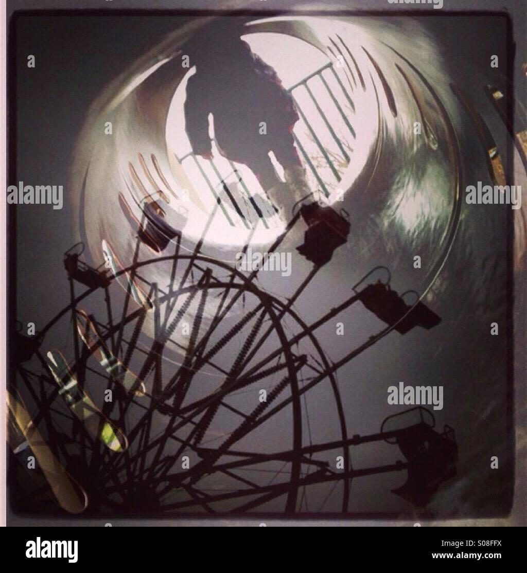 Ferris wheel and playground multiple exposure. - Stock Image