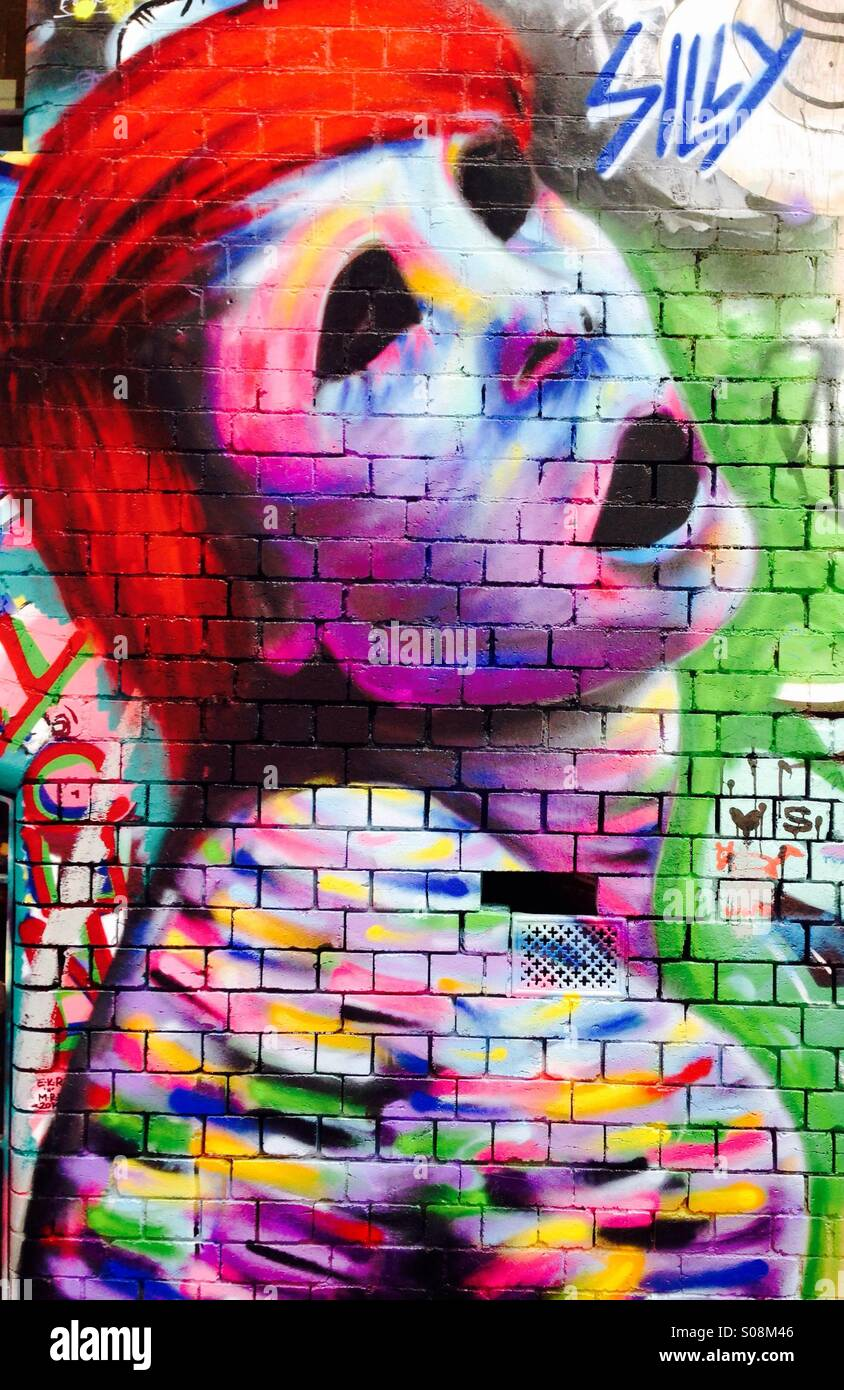 Street art of a red headed woman with empty eyes - Stock Image