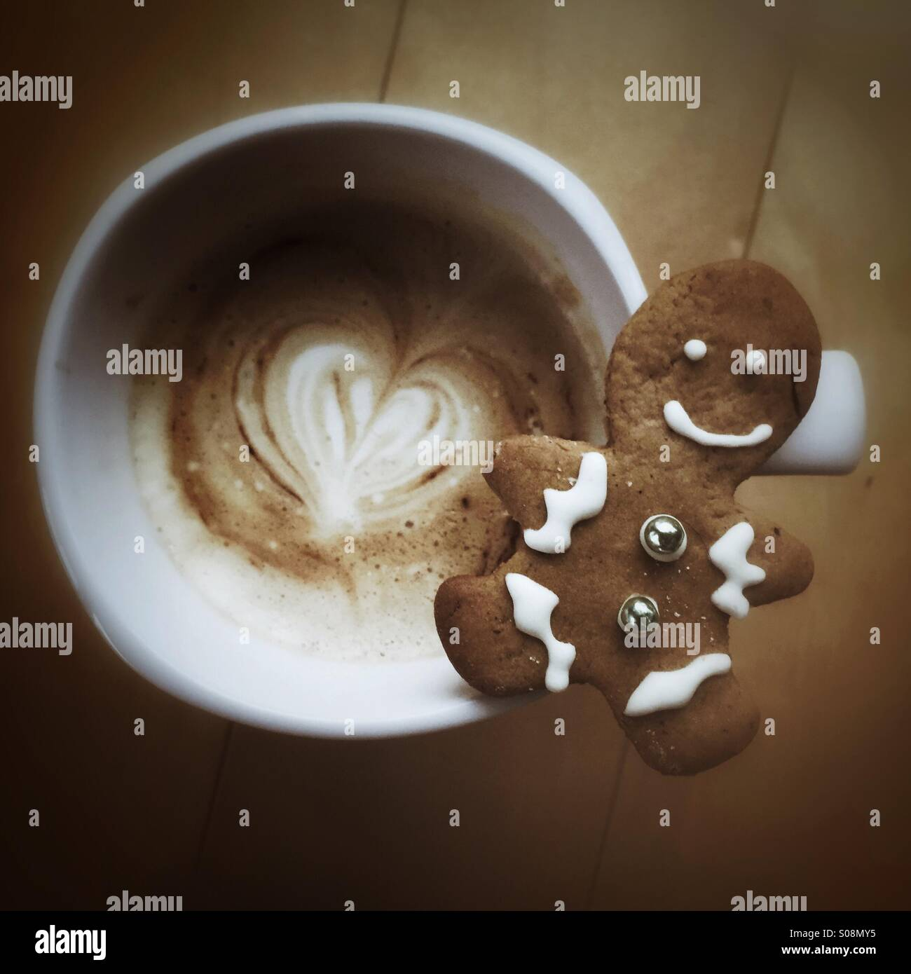 Holiday season - gingerbread cookie & latte - Stock Image