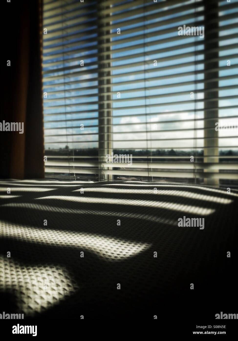 Window Venetian Blinds Casting Shadows On Bed Stock Photo 309978858
