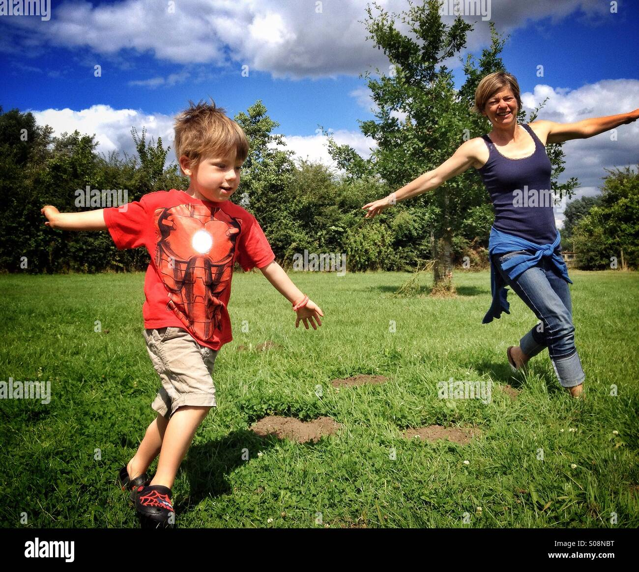 Playing aeroplanes in the sun - Stock Image
