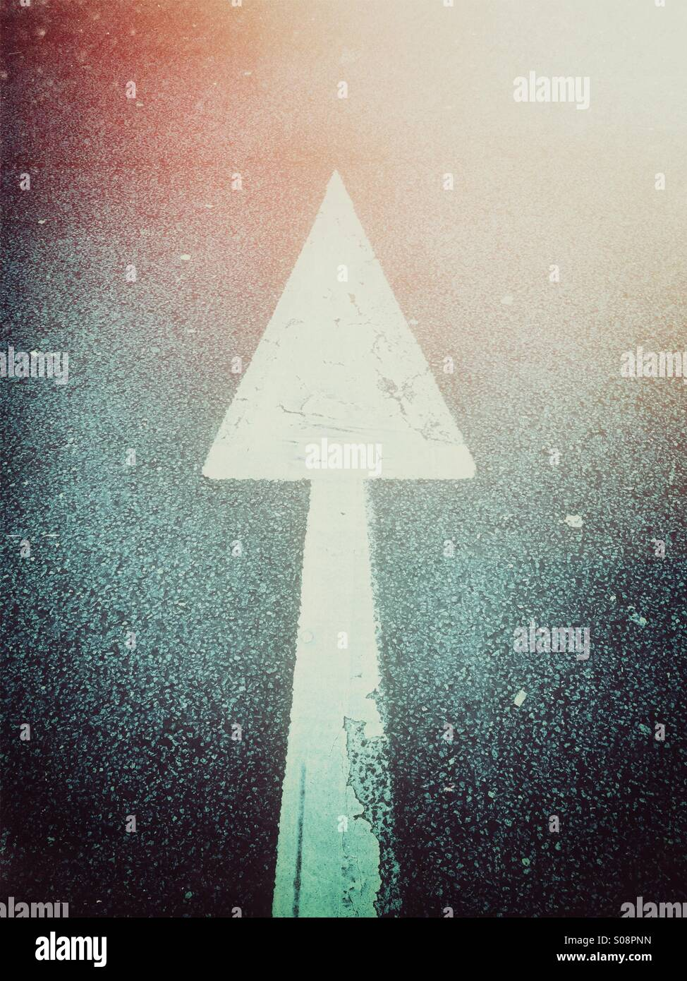 Direction arrow on asphalt - Stock Image