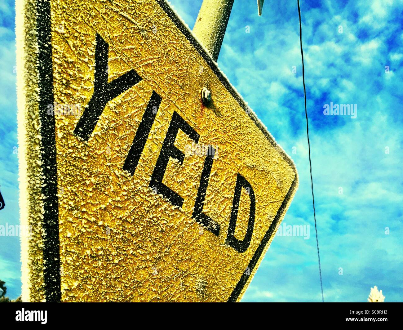 Frosted traffic sign on a cold winter morning. - Stock Image