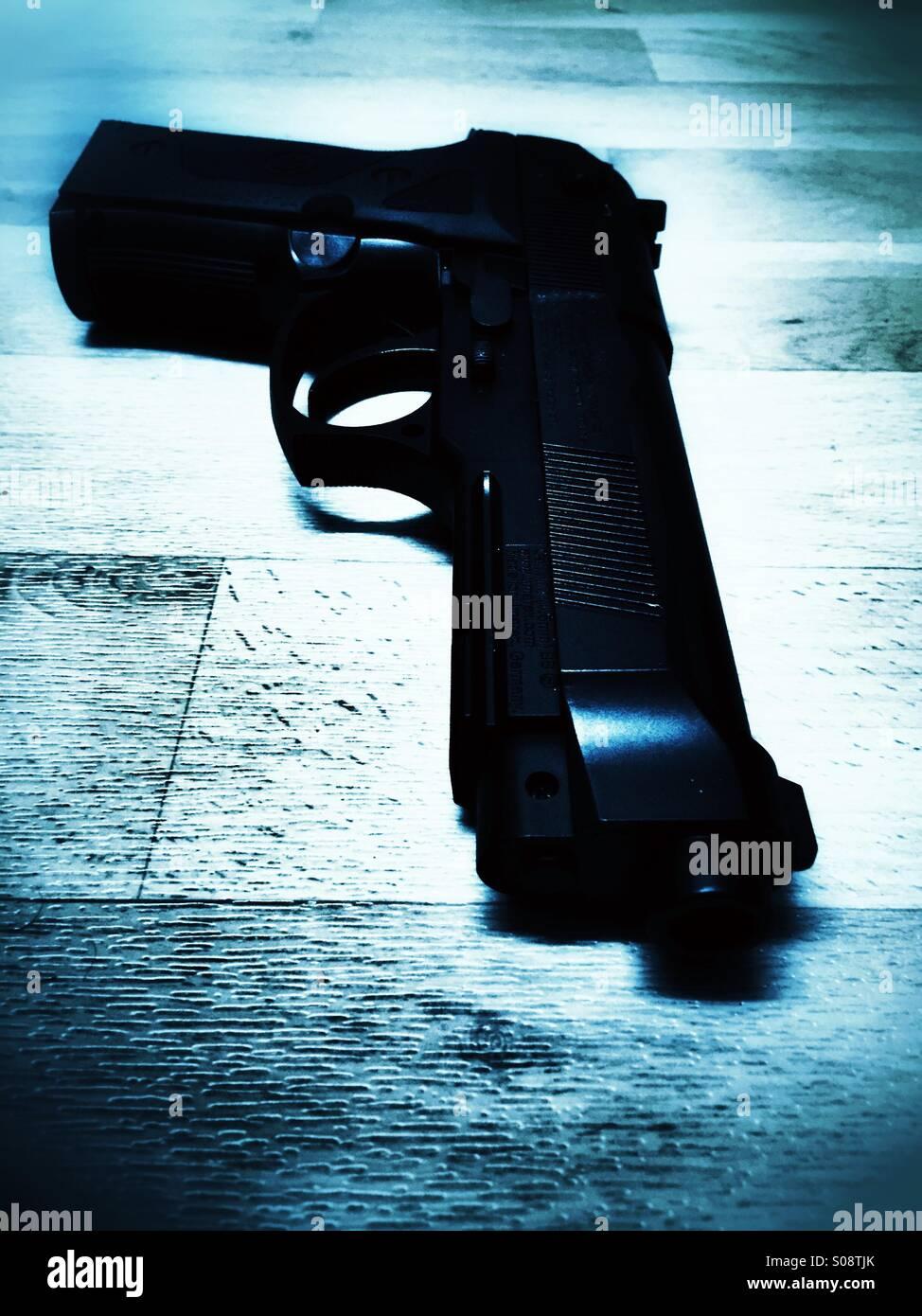 Gun on the floor , crime scene - Stock Image