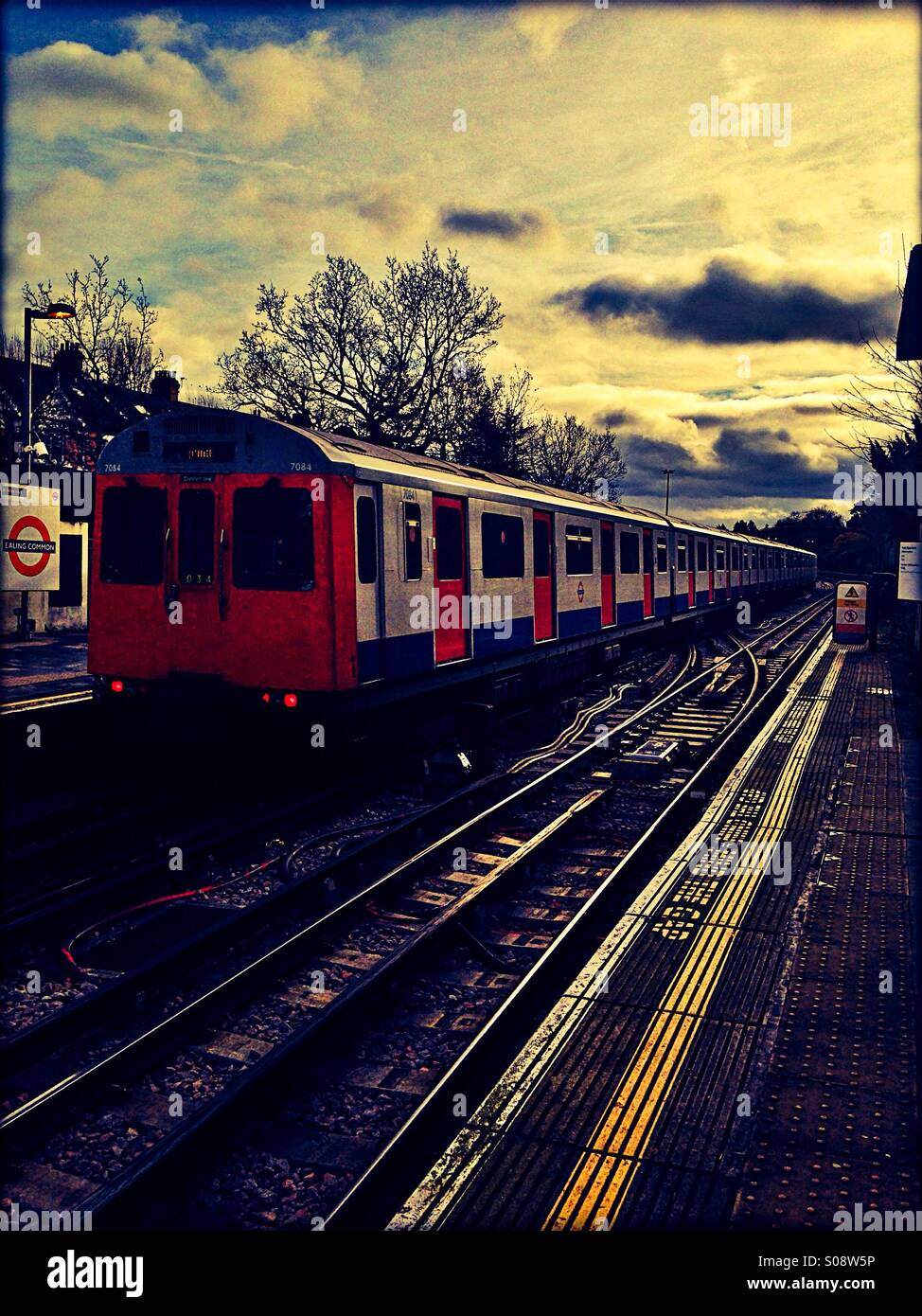 Tube train at Ealing Common, London, UK Stock Photo