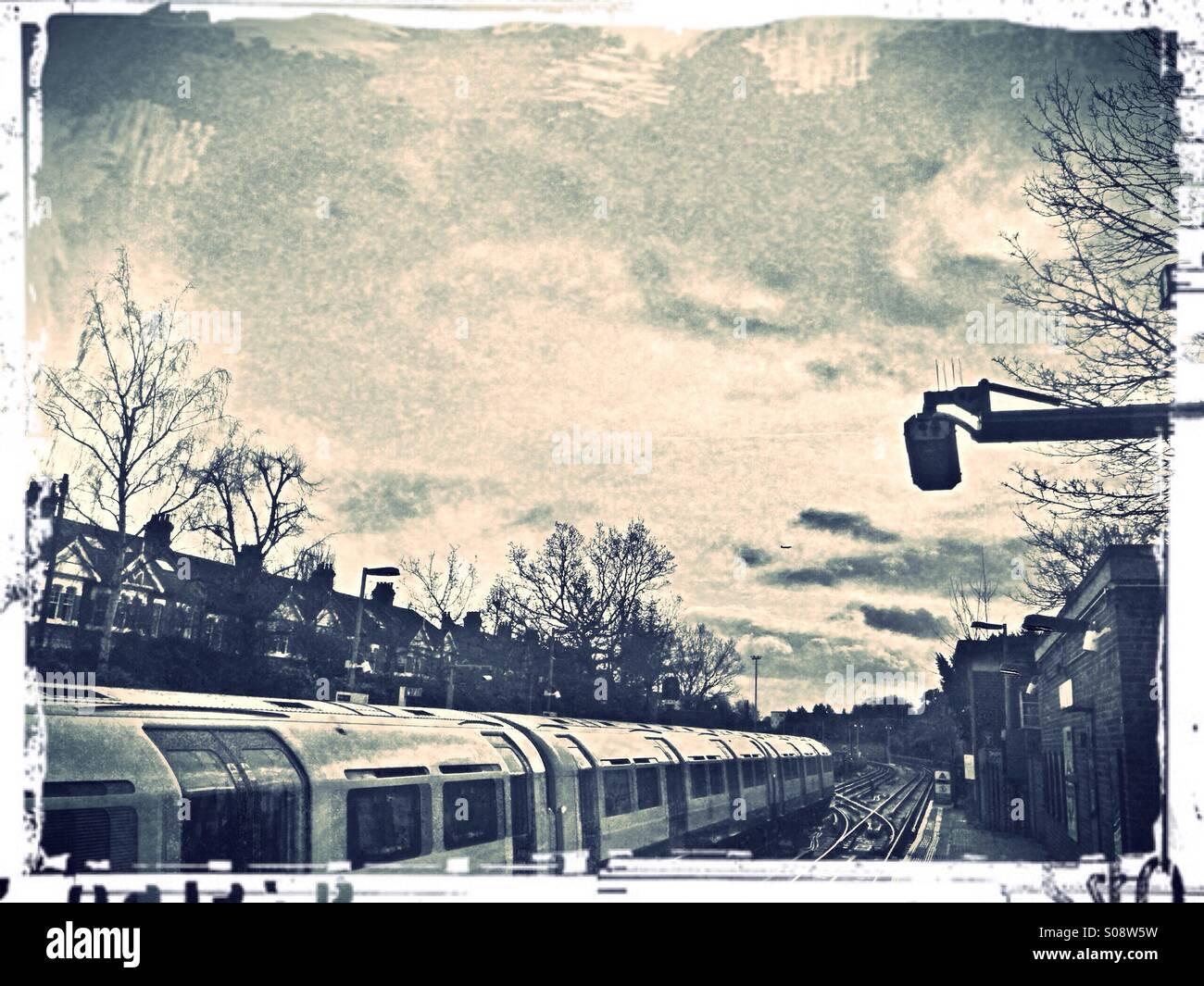 Tube train at Ealing Common underground station, London, UK Stock Photo