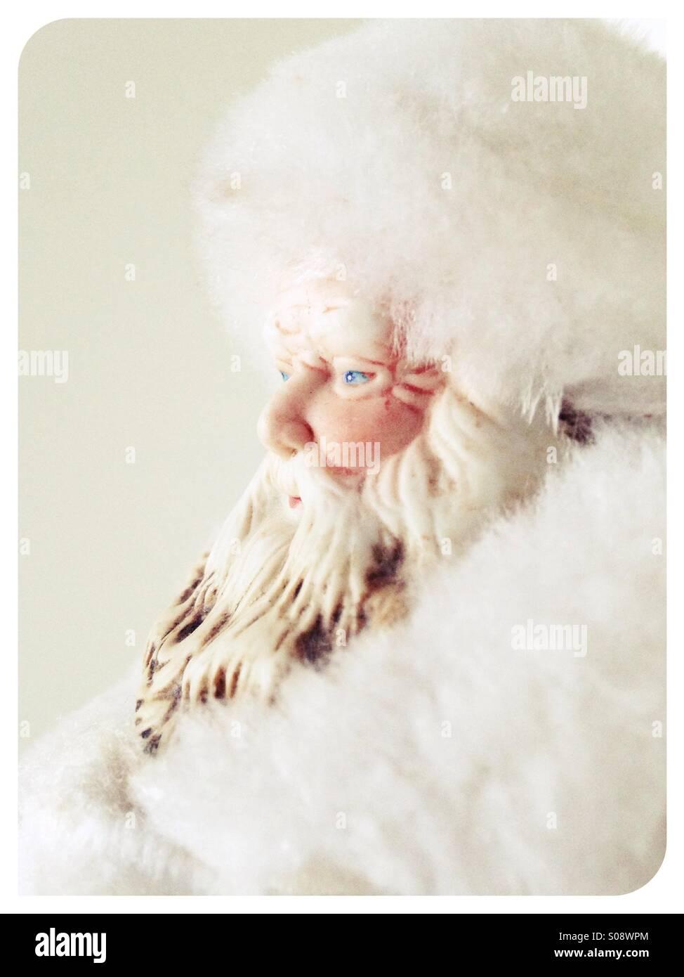 A Santa Claus figurine, all in white. - Stock Image
