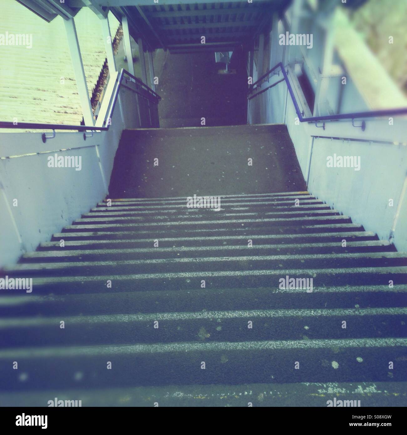 Looking down train station steps - Stock Image