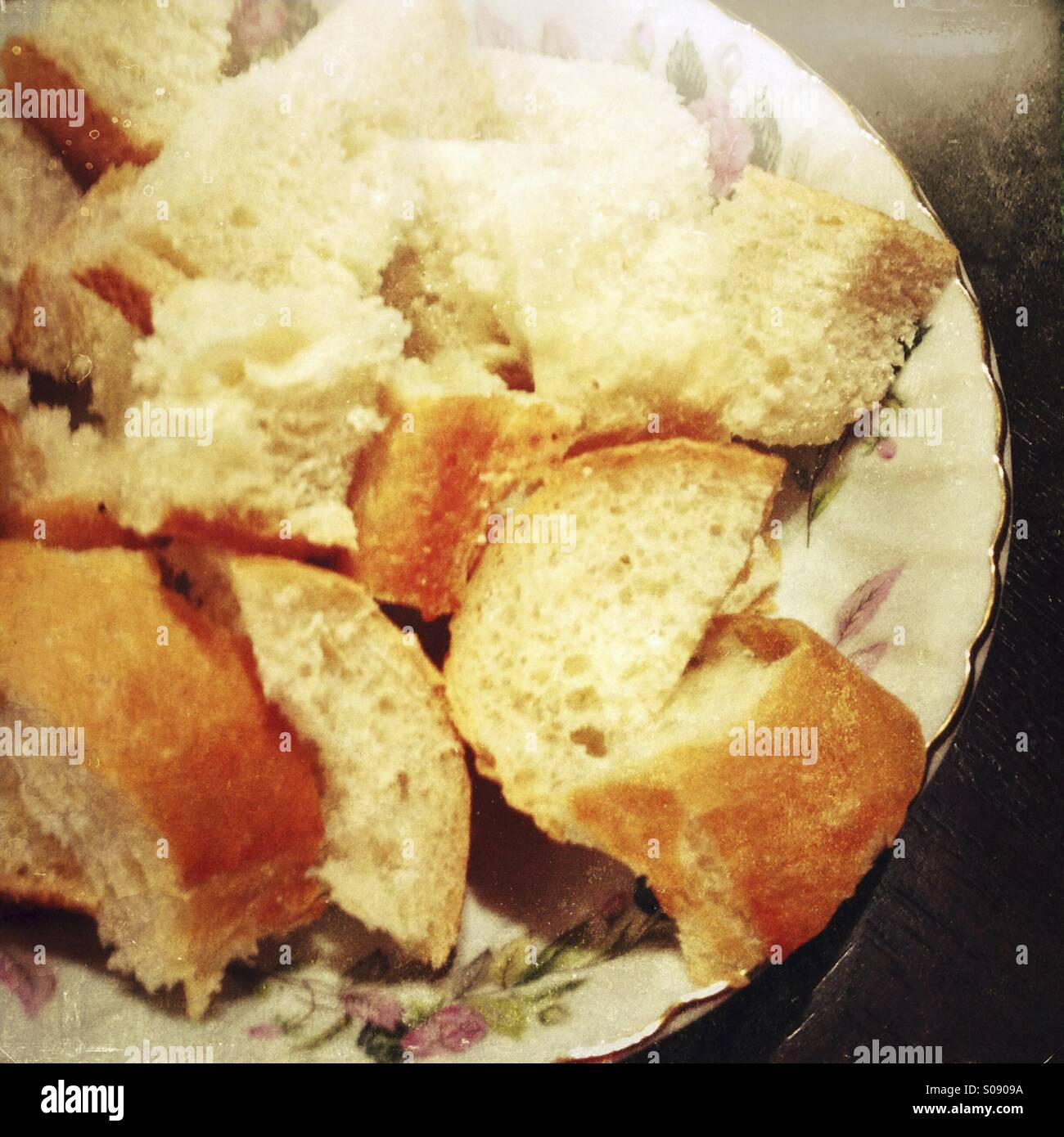 Pieces of bread on a plate. - Stock Image