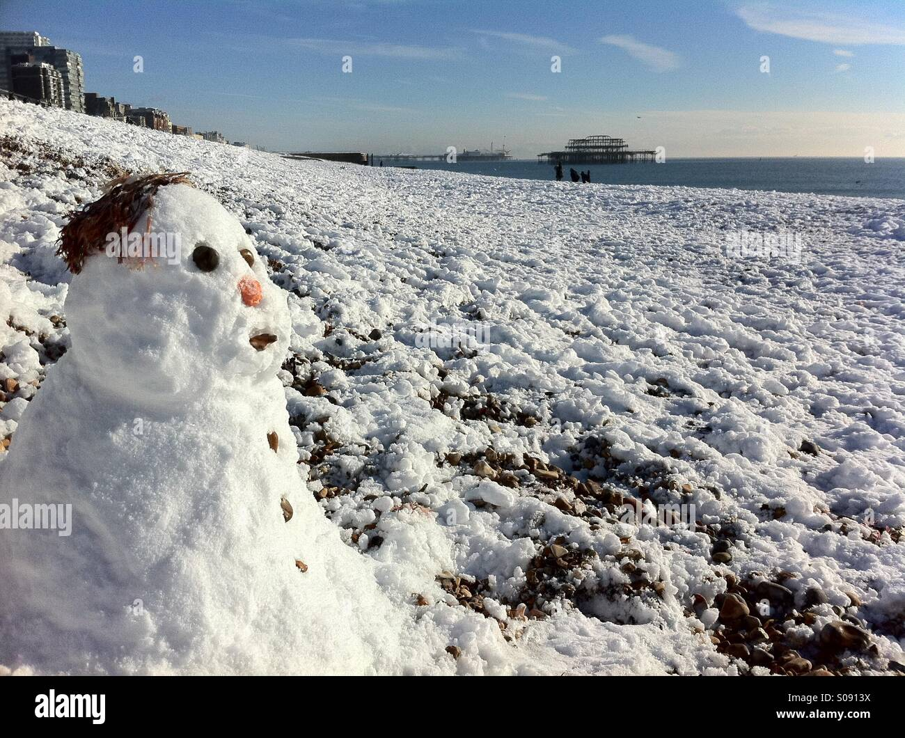 snowman on Brighton beach. England - Stock Image