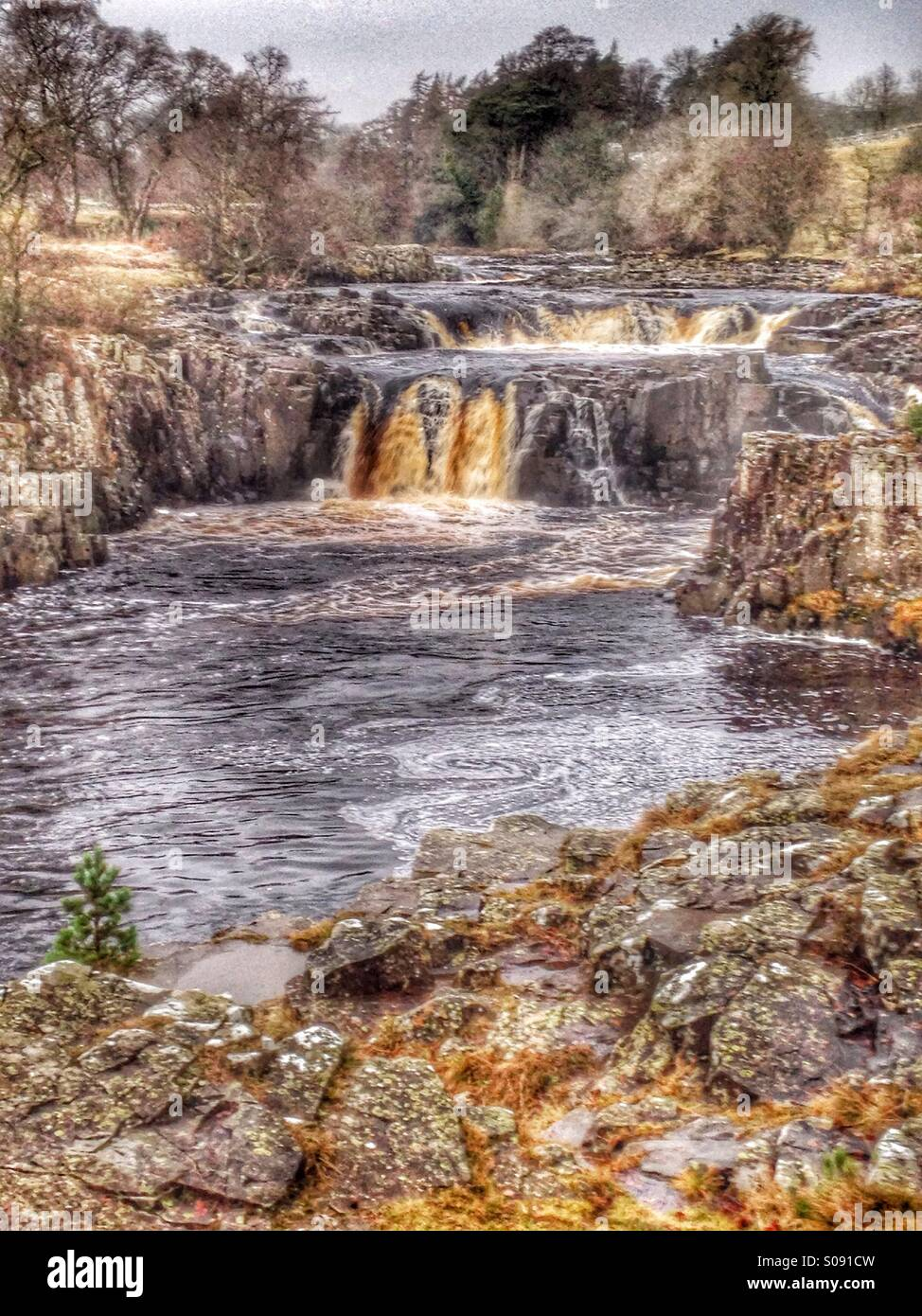 Low force waterfall at Bowlees in County Durham, UK - Stock Image