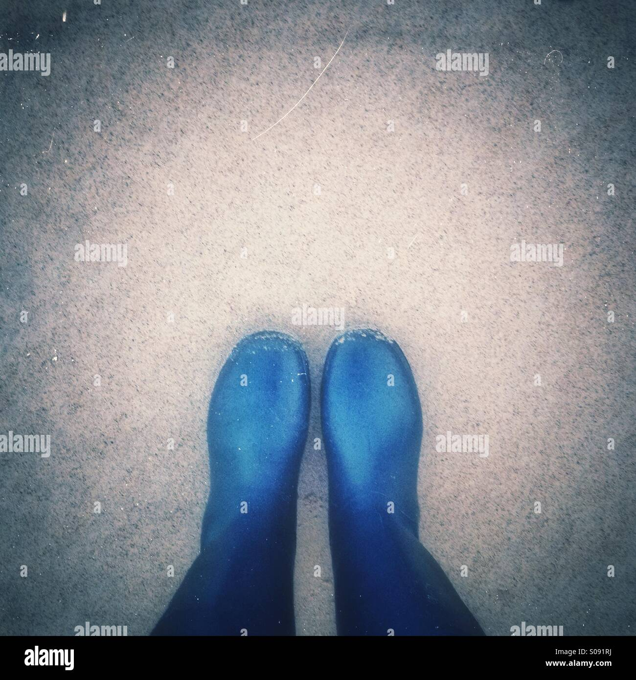Looking down on wellies - Stock Image