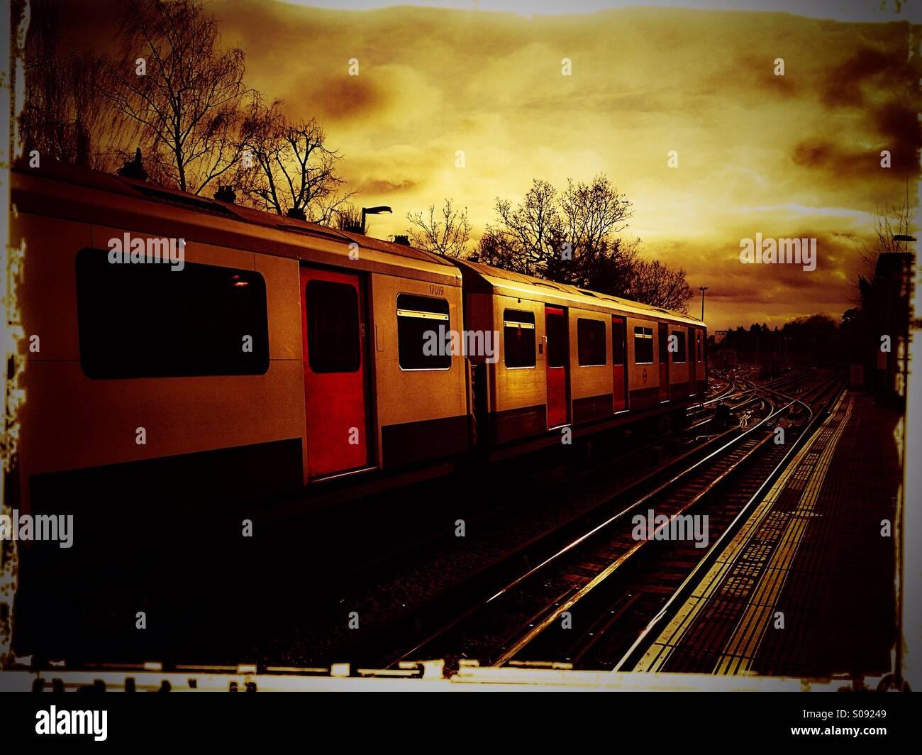 Tube train in transit, Ealing Common, London, UK Stock Photo