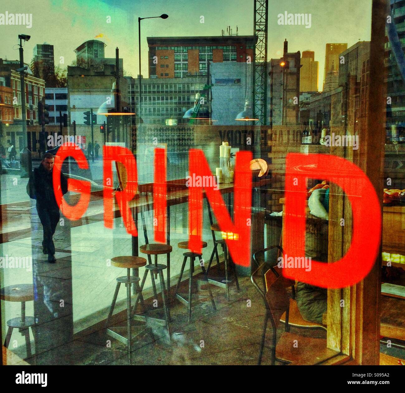 A sign saying Grind at the Shoreditch Grind coffee shop, London - Stock Image