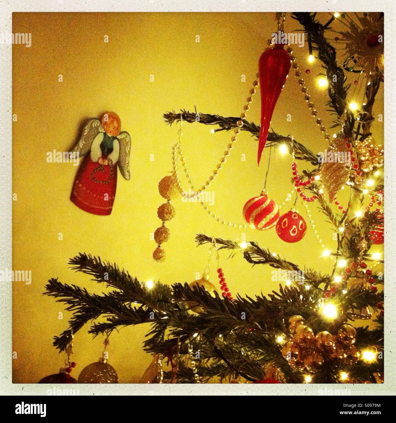 Christmas scene with a decorated Christmas tree and an angel hanging ...