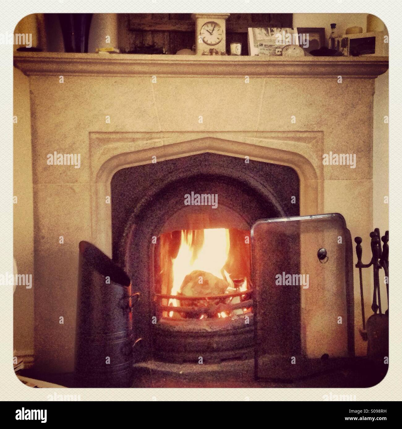 A fire is seen lit for the winter evenings. - Stock Image