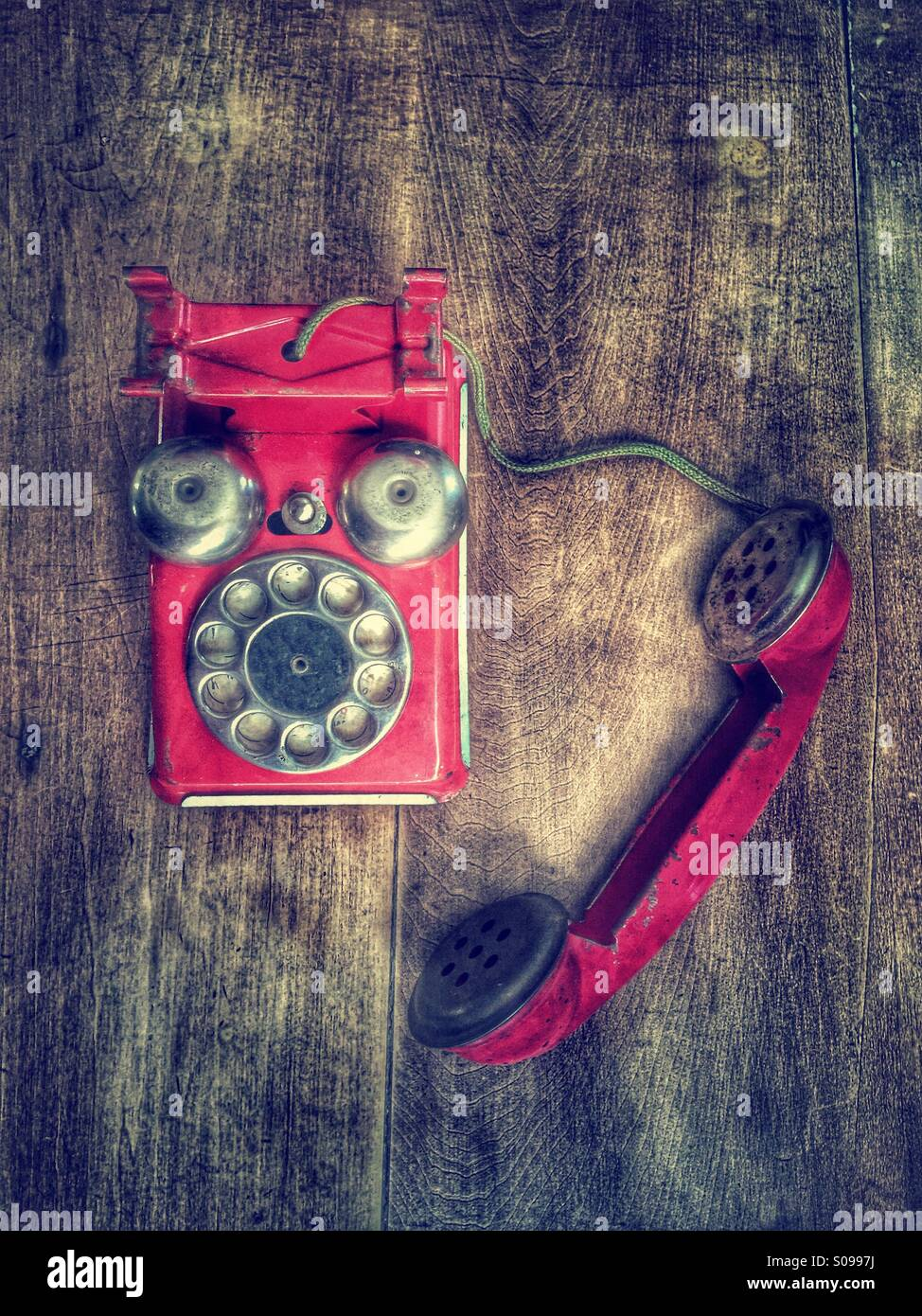 Red vintage toy telephone. - Stock Image