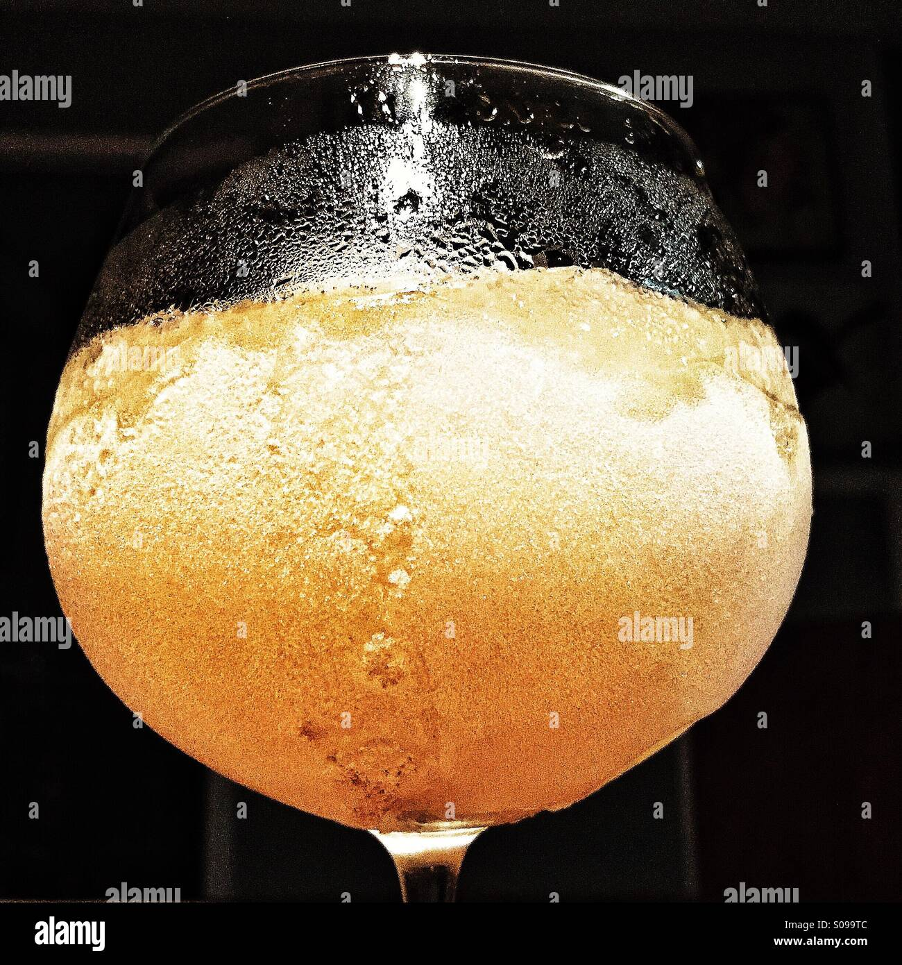 mixed frozen slushy girly drink in a brandy snifter - Stock Image