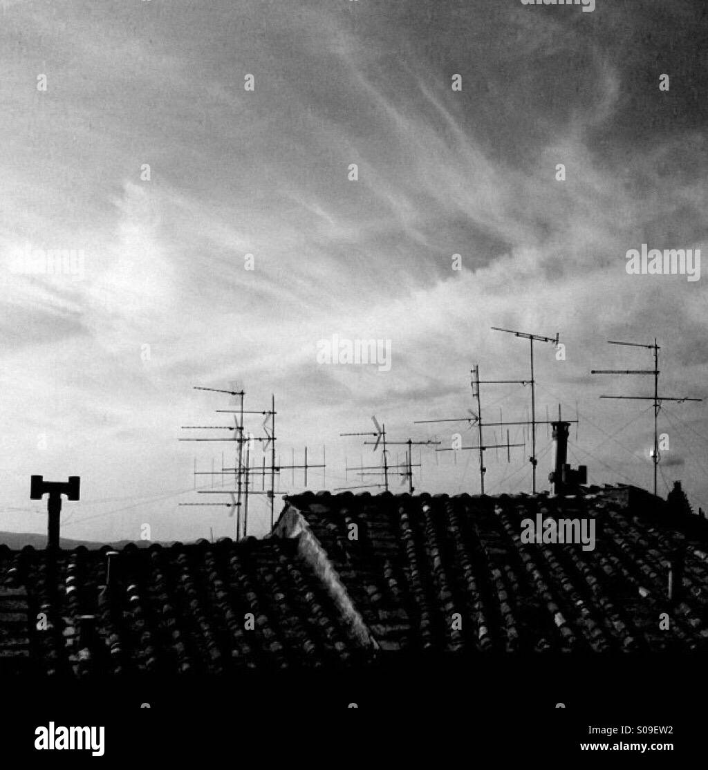 A roof filled with aerials in Sienna, Italy - Stock Image