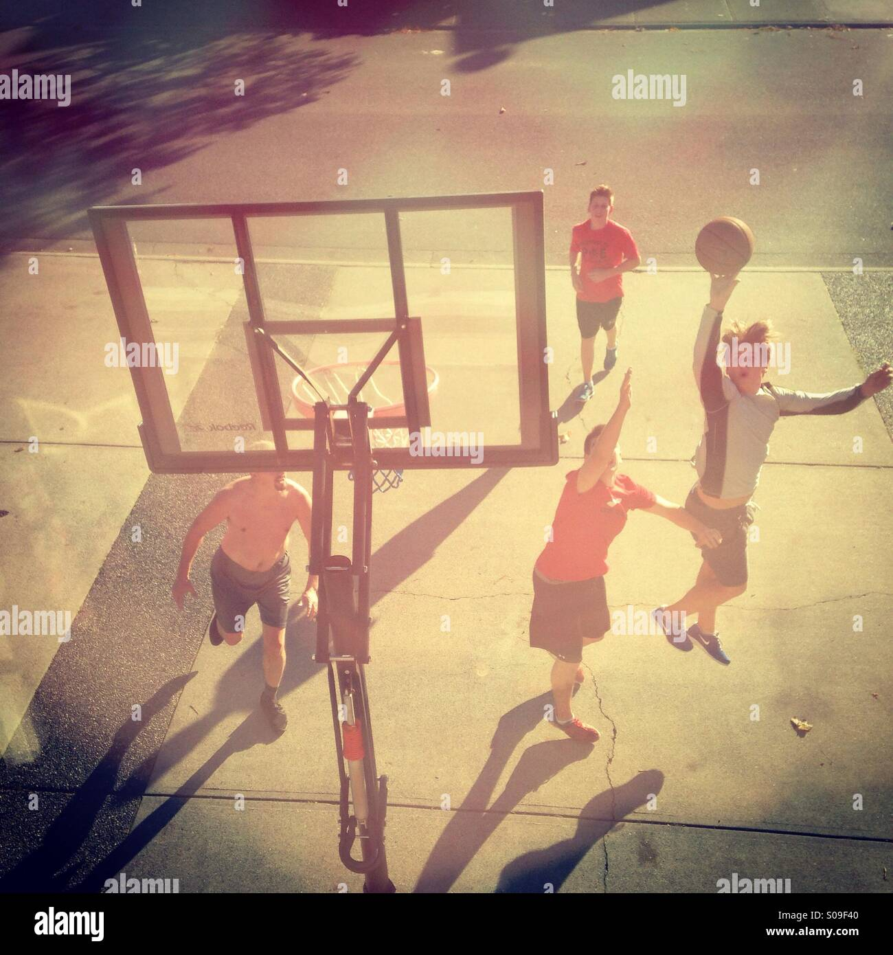 Dad and Boys playing basket ball - Stock Image