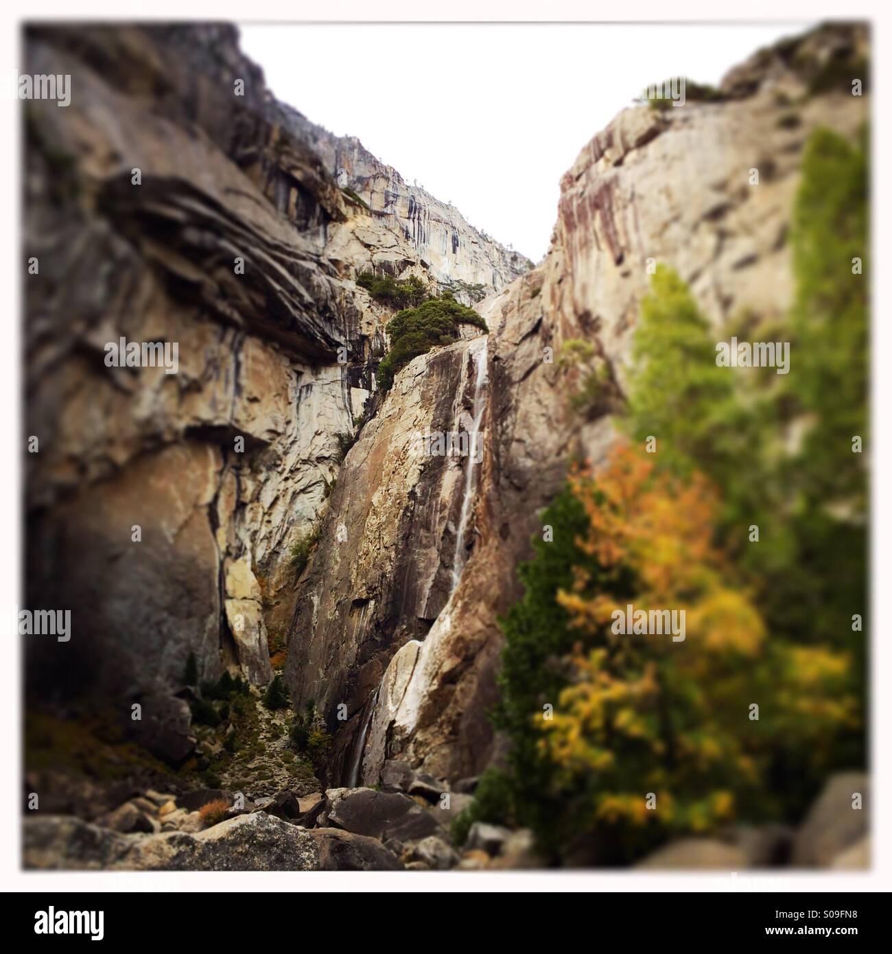 Lower Yosemite Falls at a trickle during fall. Yosemite Valley, Yosemite National Park, Mariposa County, California, - Stock Image