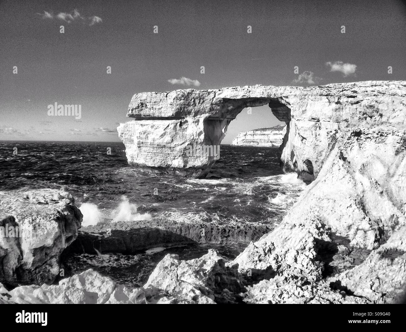 Stormy winter seas at Azure Window.  Monochrome - Stock Image