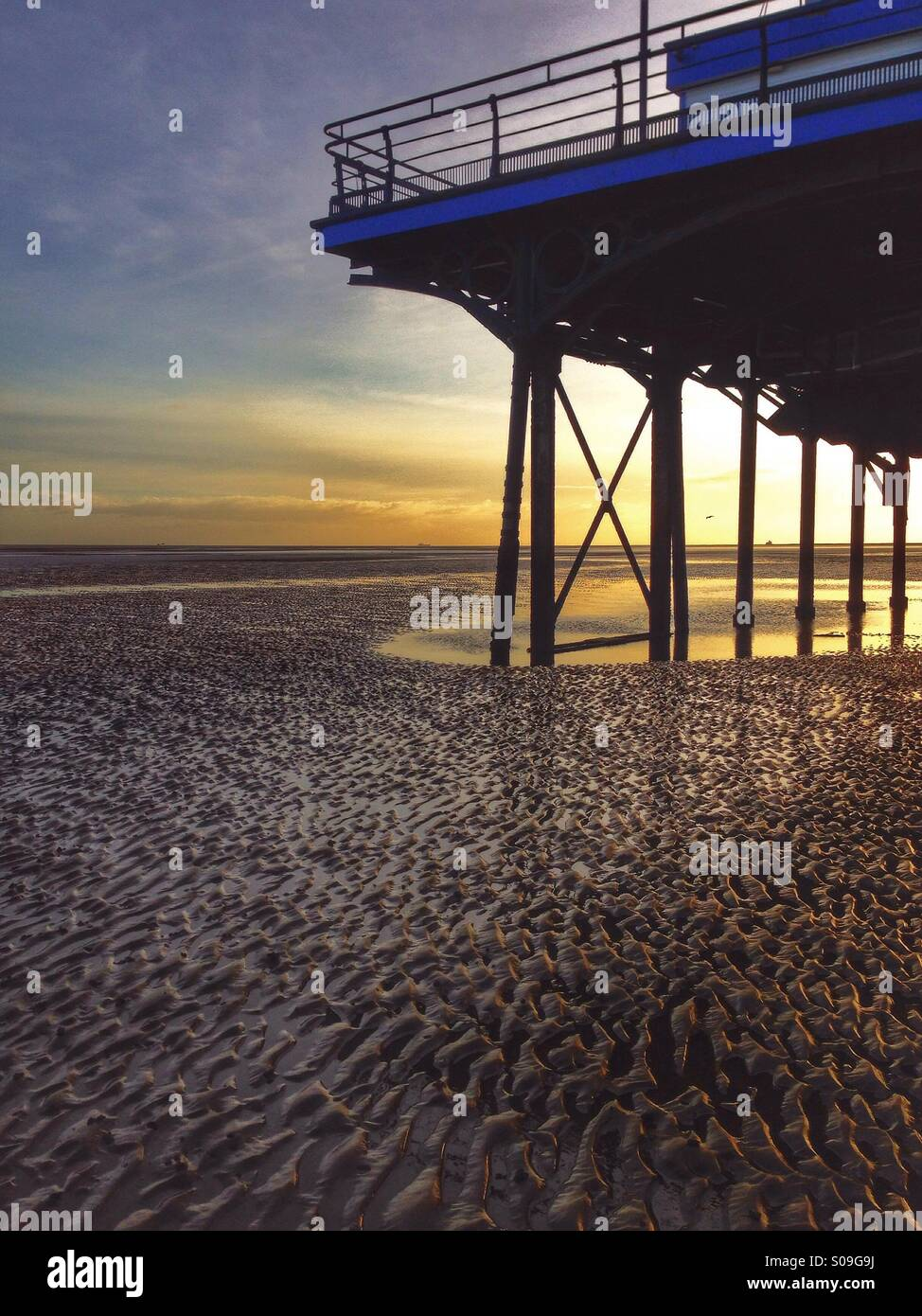 Traditional pier seen in detail at sunrise. - Stock Image