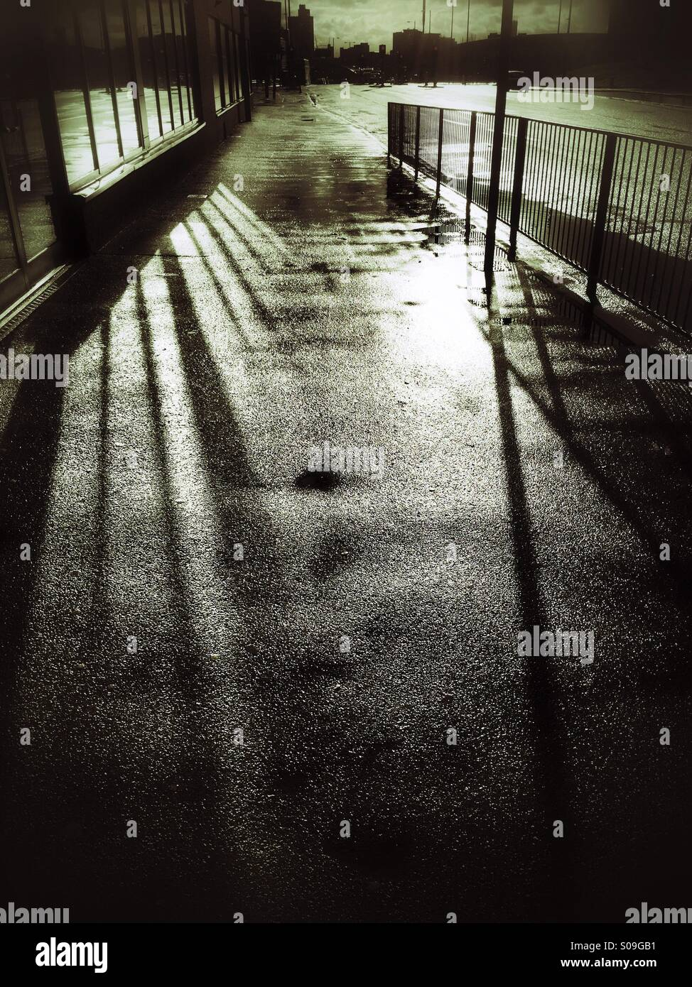Shadowy pavement - Stock Image