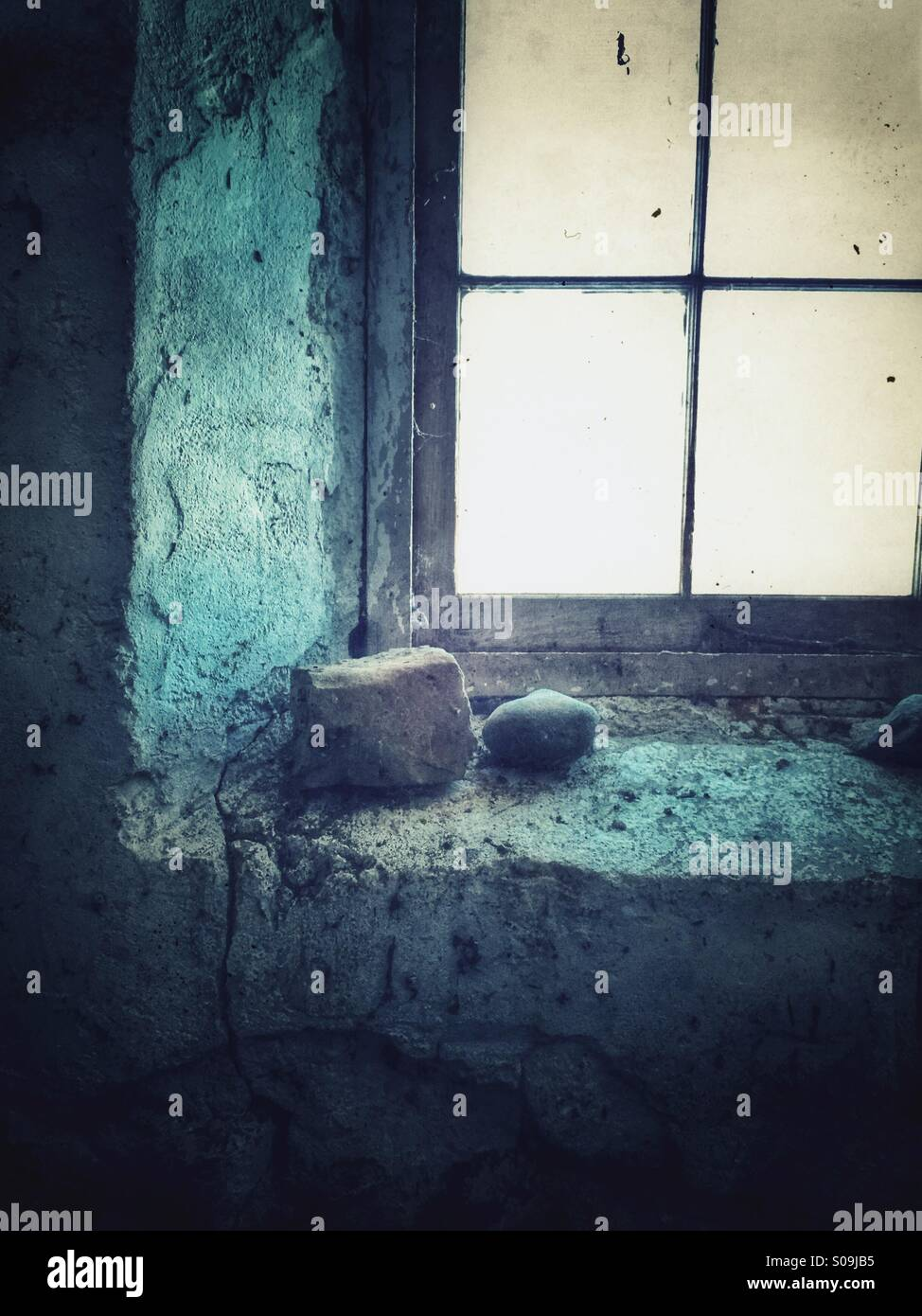Rocks on the windowsill. - Stock Image