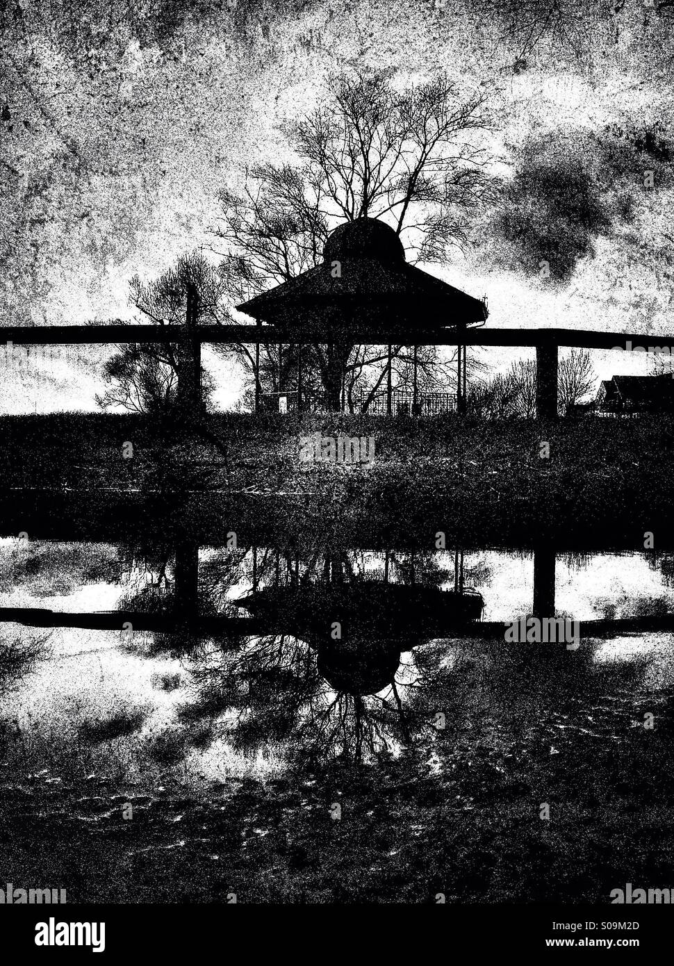Bandstand reflections on a puddle - Stock Image