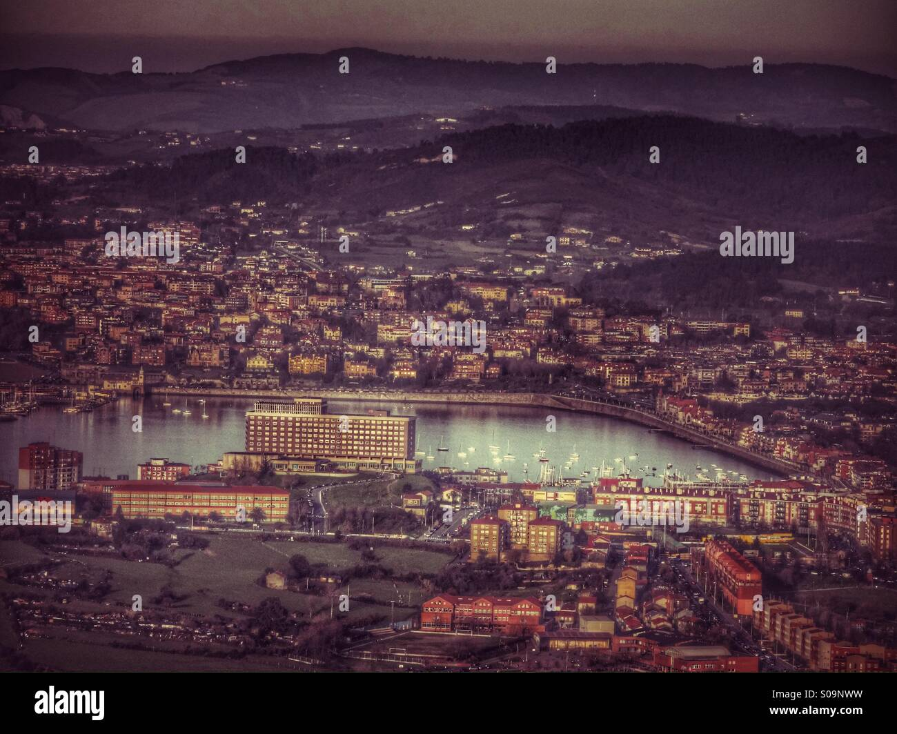 City, mountain, sea and sailing boats - Stock Image