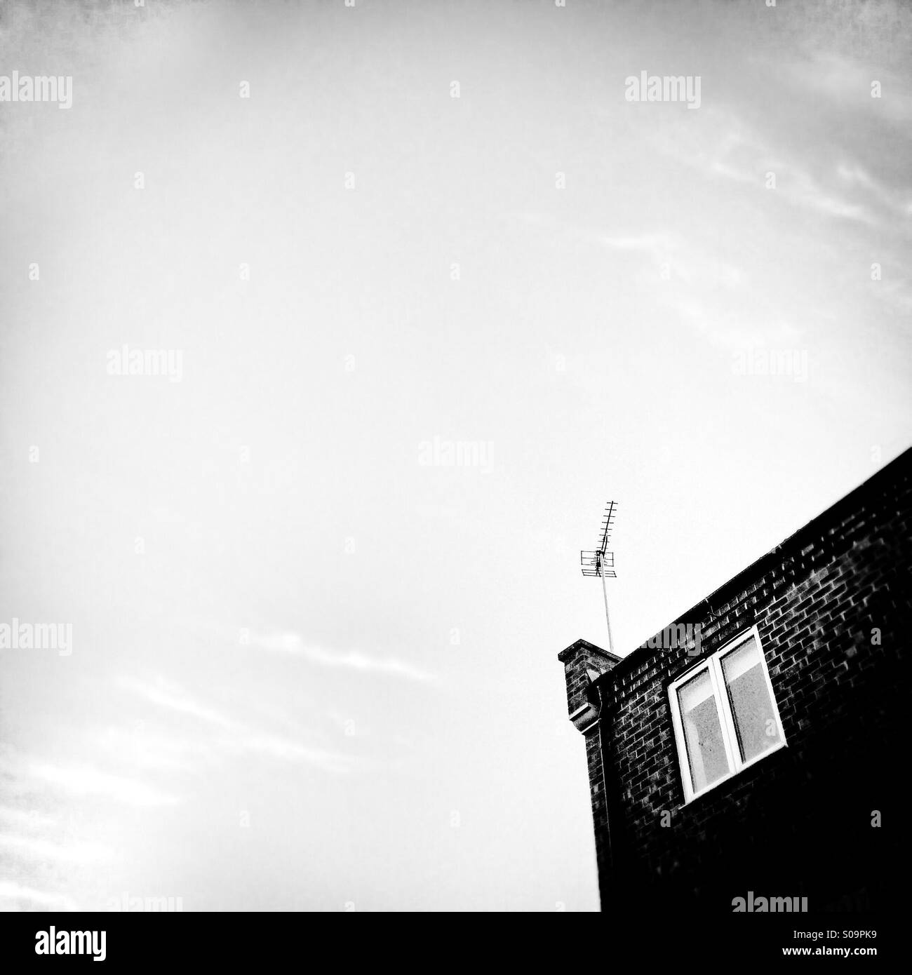 Television aerial on roof of house - Stock Image
