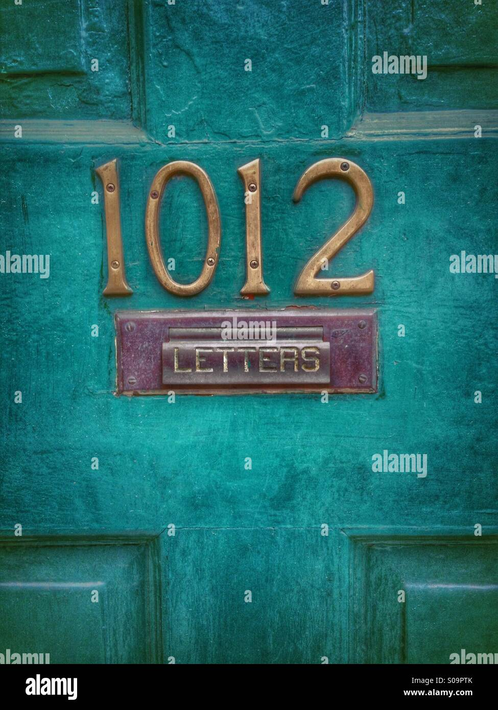 Letterbox on old door. - Stock Image