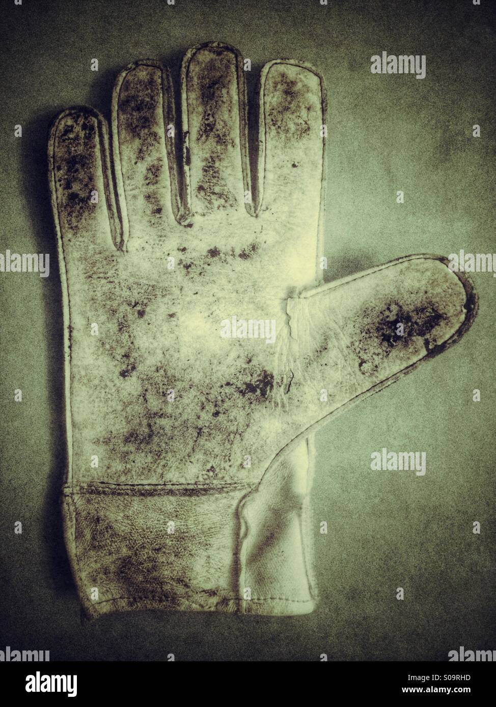 A dirty goalkeepers glove - Stock Image