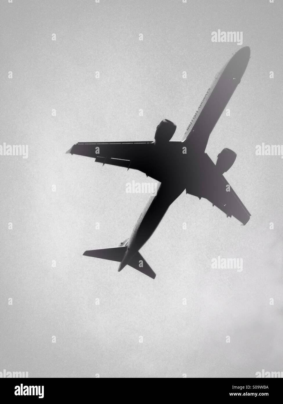 Low flying passenger aircraft coming in to land - Stock Image
